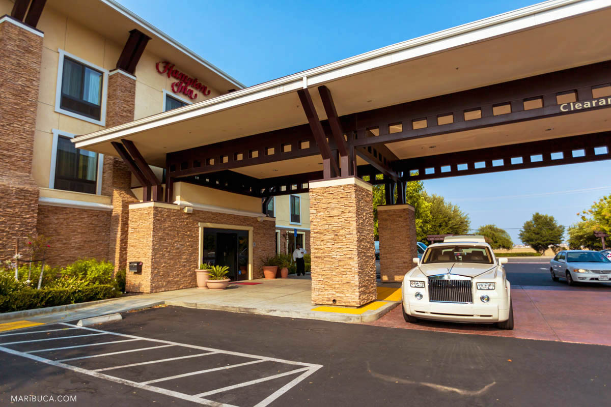 The Hampton Inn hotel and the white limo in the Brentwood wedding