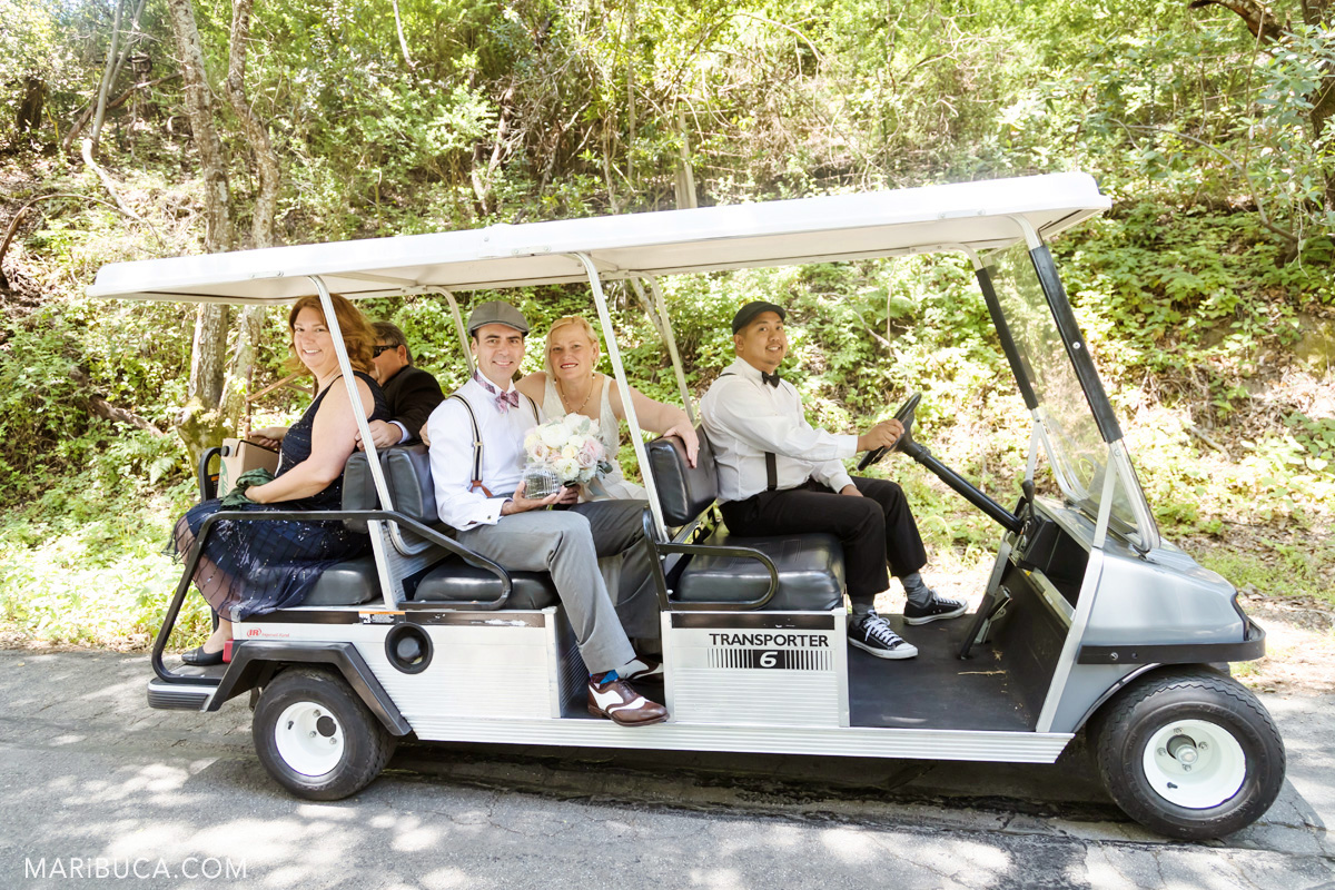 Wedding in the Los Gatos where newlyweds couple with  friends use golf cart.