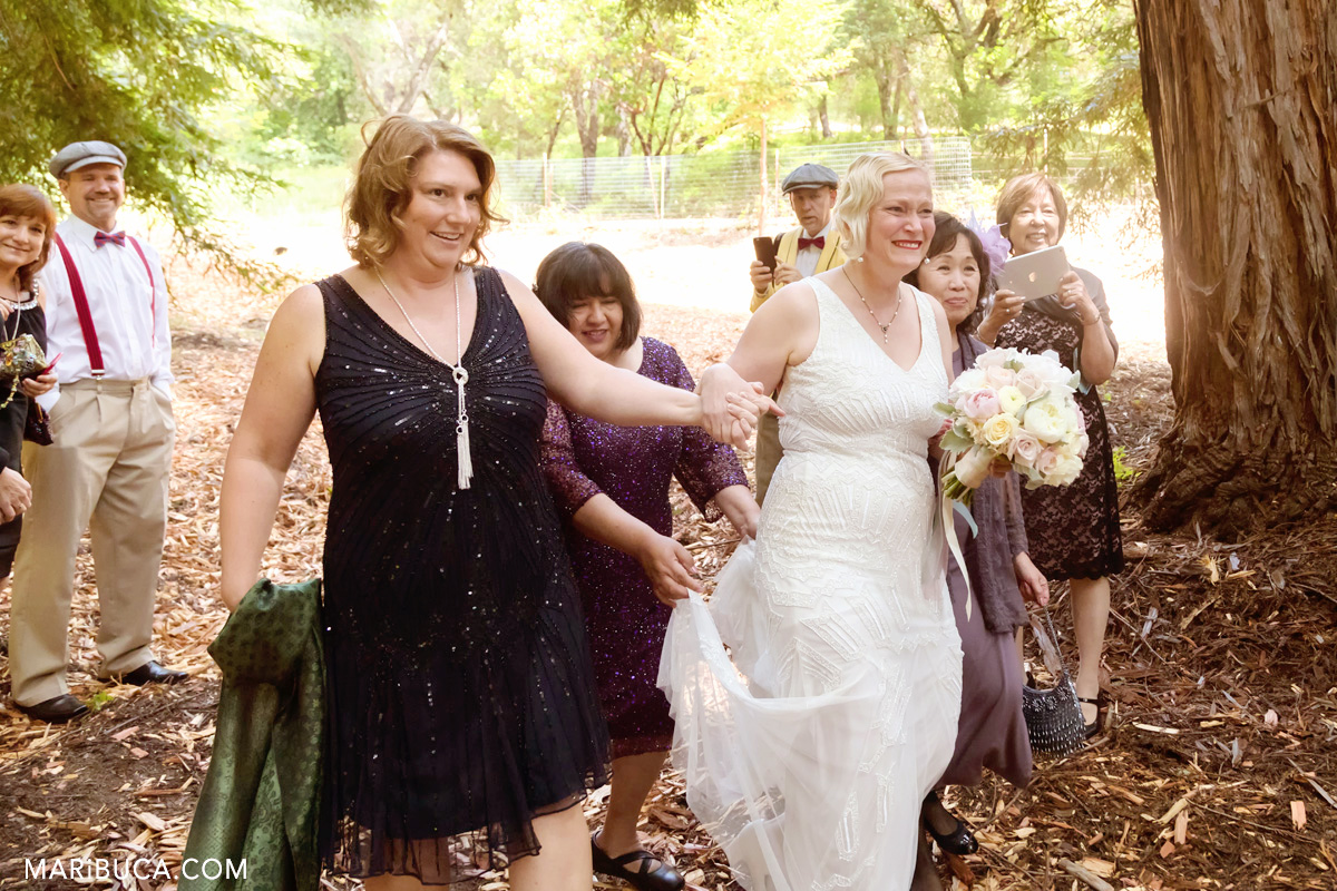 The bride comes down the aisle, and cries with happiness in the wedding day.