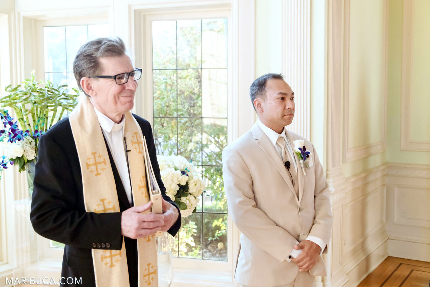 Groom and Wedding officiant are expecting the bride in the Dining room, Kohl Mansion Wedding