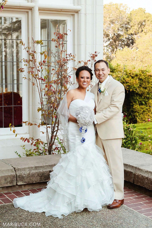 bride and groom hug and smile at Kohl Mansion Wedding