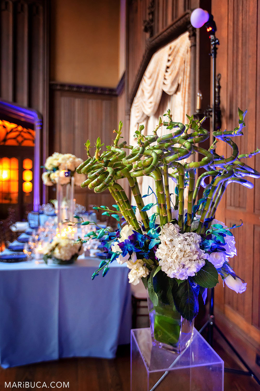 Decoration in the Great Hall, Kohl Mansion such as bouquet flower, burning candles and light blue table in the background with beautiful decorations.
