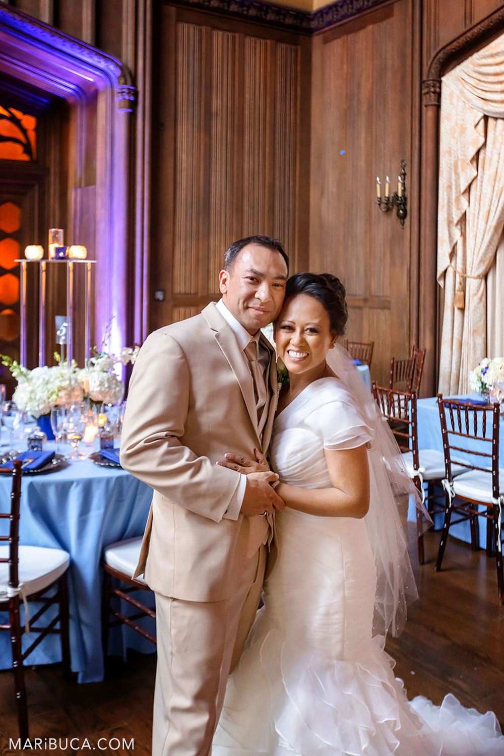 Newlywed couple stand in the Great Hall, Kohl Mansion