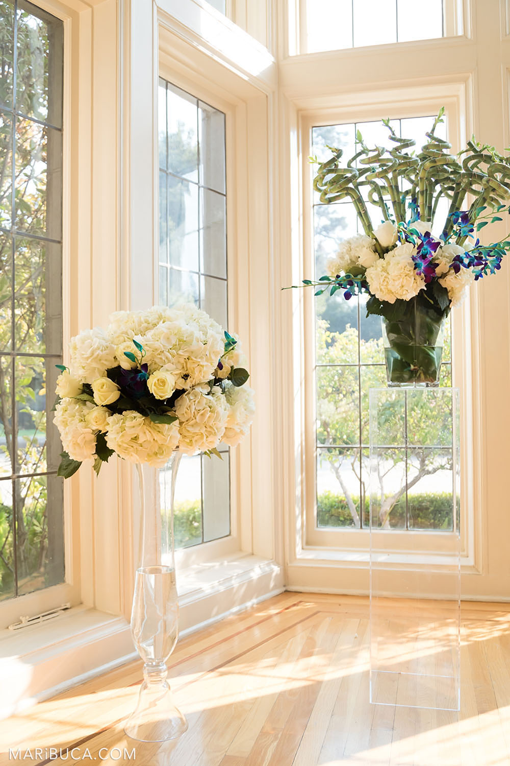 the white hall for the wedding ceremony is decorated with white flowers in the high vases in the sunny day, Dining room, Kohl Mansion, Burlingame