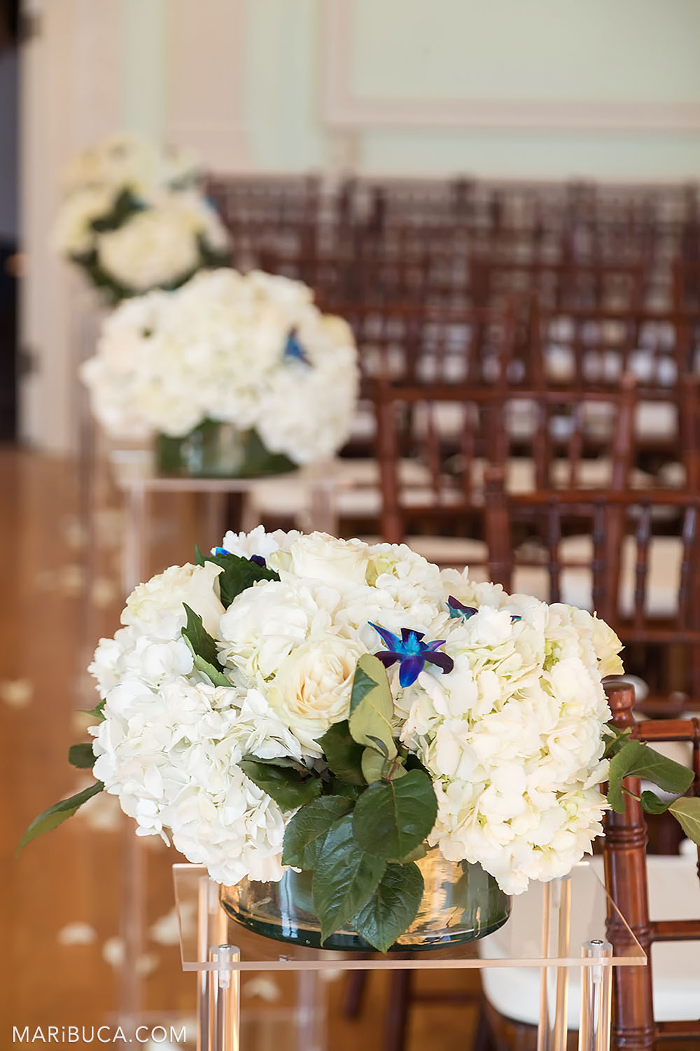 Wedding ceremony decorations: white bouquets and brown wooden chairs in the Dining room, Kohl Mansion, Burlingame