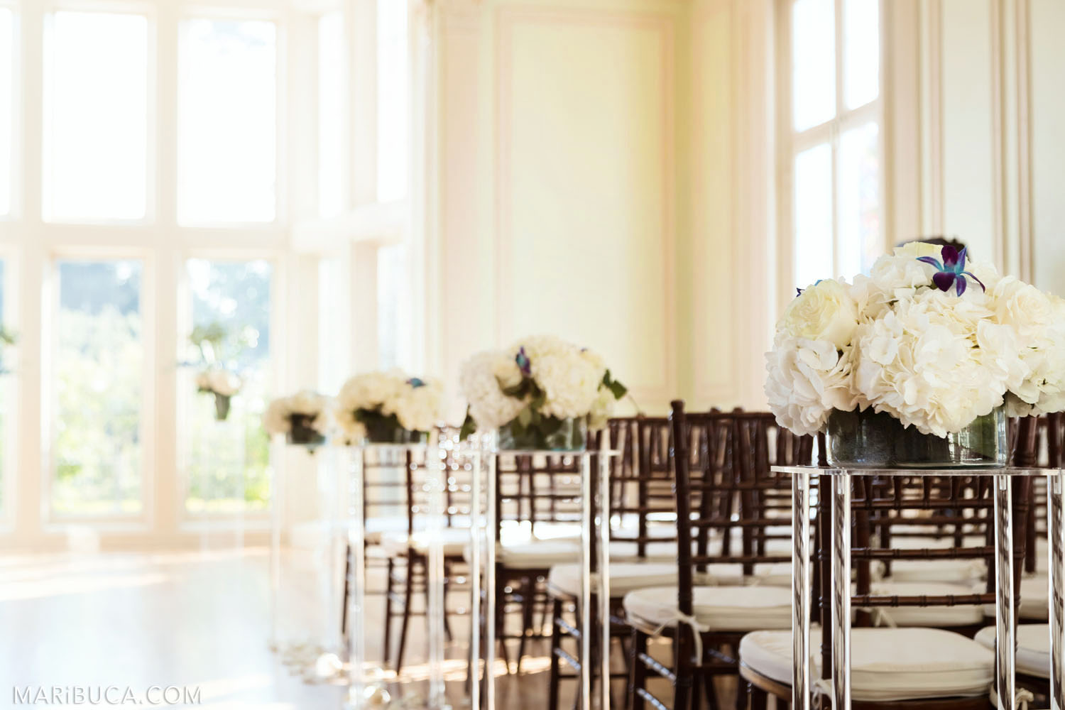 the white hall for the wedding ceremony is decorated with white flowers, the high vases and big light windows in the sunny day, Dining room, Kohl Mansion, Burlingame