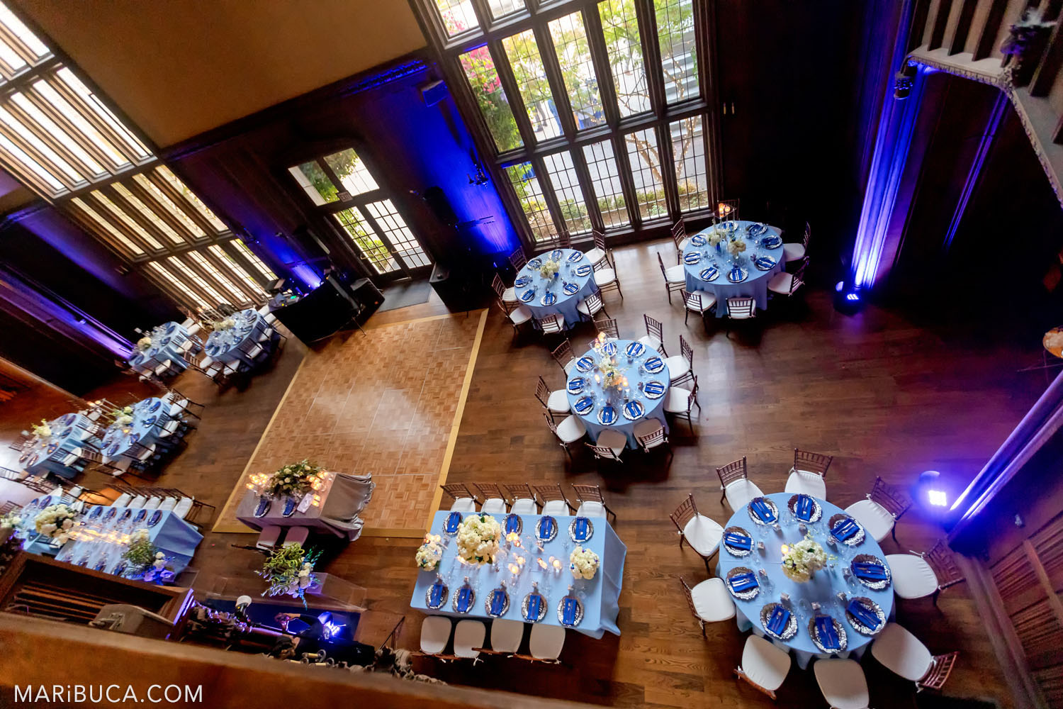 unforgettable view from the second floor to Great Hall, Kohl Mansion, Burlingame as the blue wedding theme for the wedding reception.