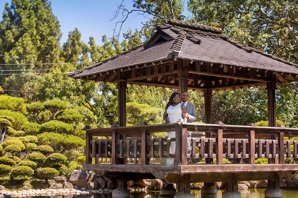 Newlyweds are staying in the gazebo during hot summer time in the Hayward Japanese Garden.