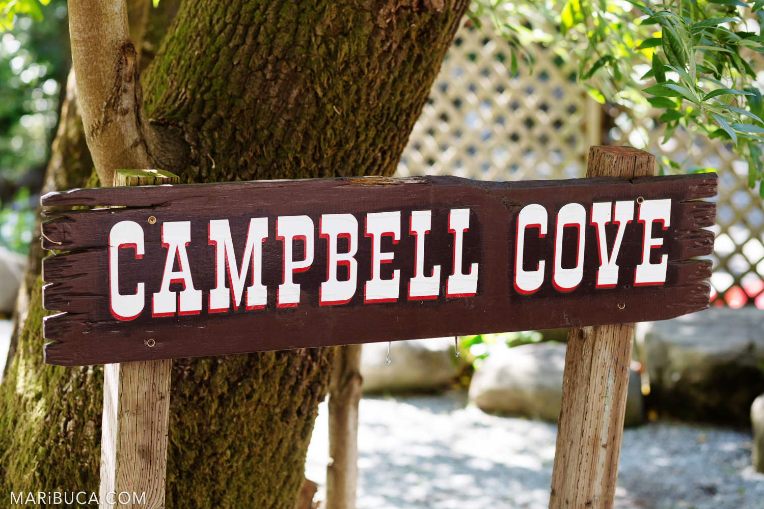 "Saratoga Springs Venue - brown wooden sign ""Campbell Cove"""