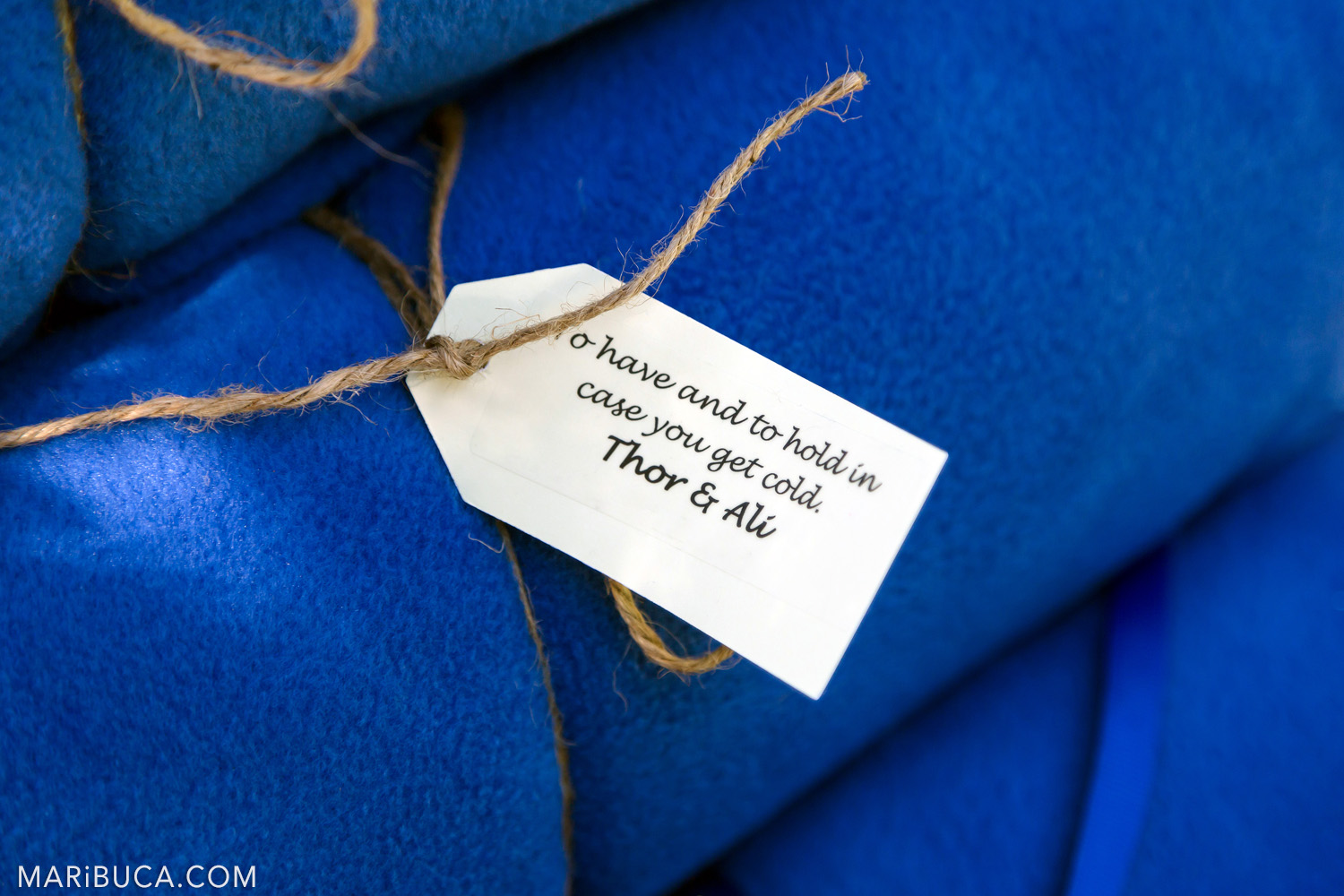 Wedding tag for the wedding surrounded navy blue blankets in the in the Saratoga Springs Wedding