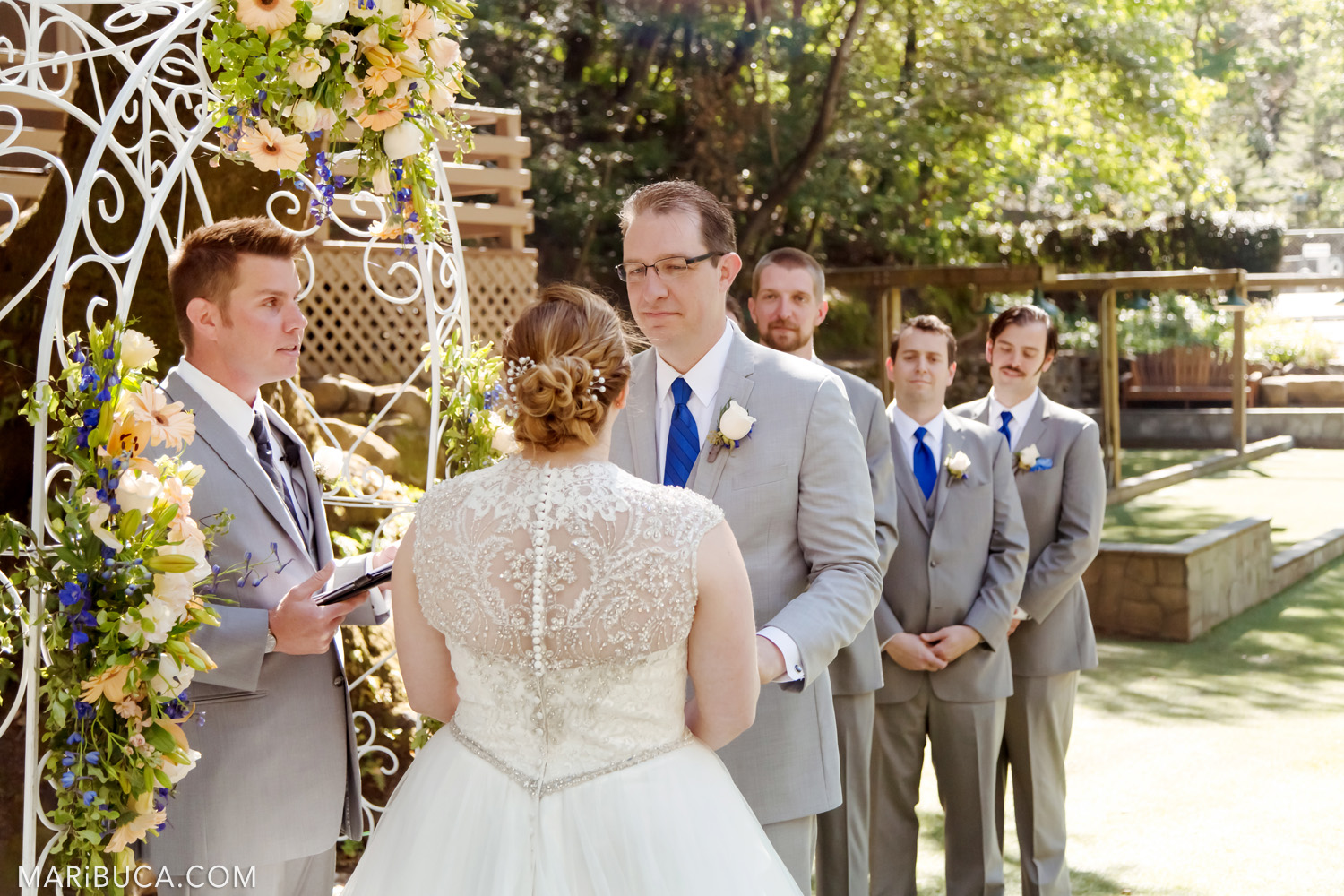 The groom looks in her fabiolus bride in the wedding ceremony in the in the Saratoga Springs Venue