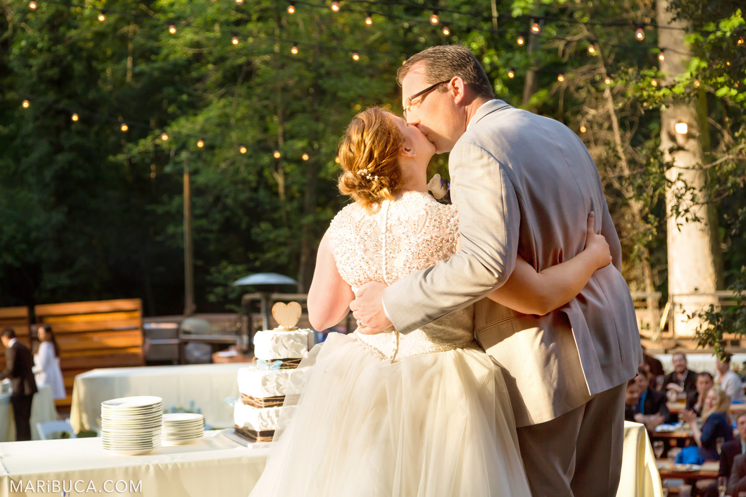 Bride and groom kiss each other in front of the guests in the Saratoga Springs Wedding