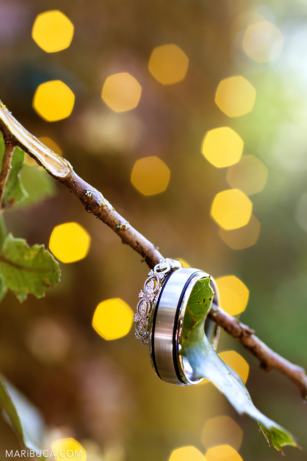 Wedding rings and yellow bokeh as background in the Saratoga Springs Wedding