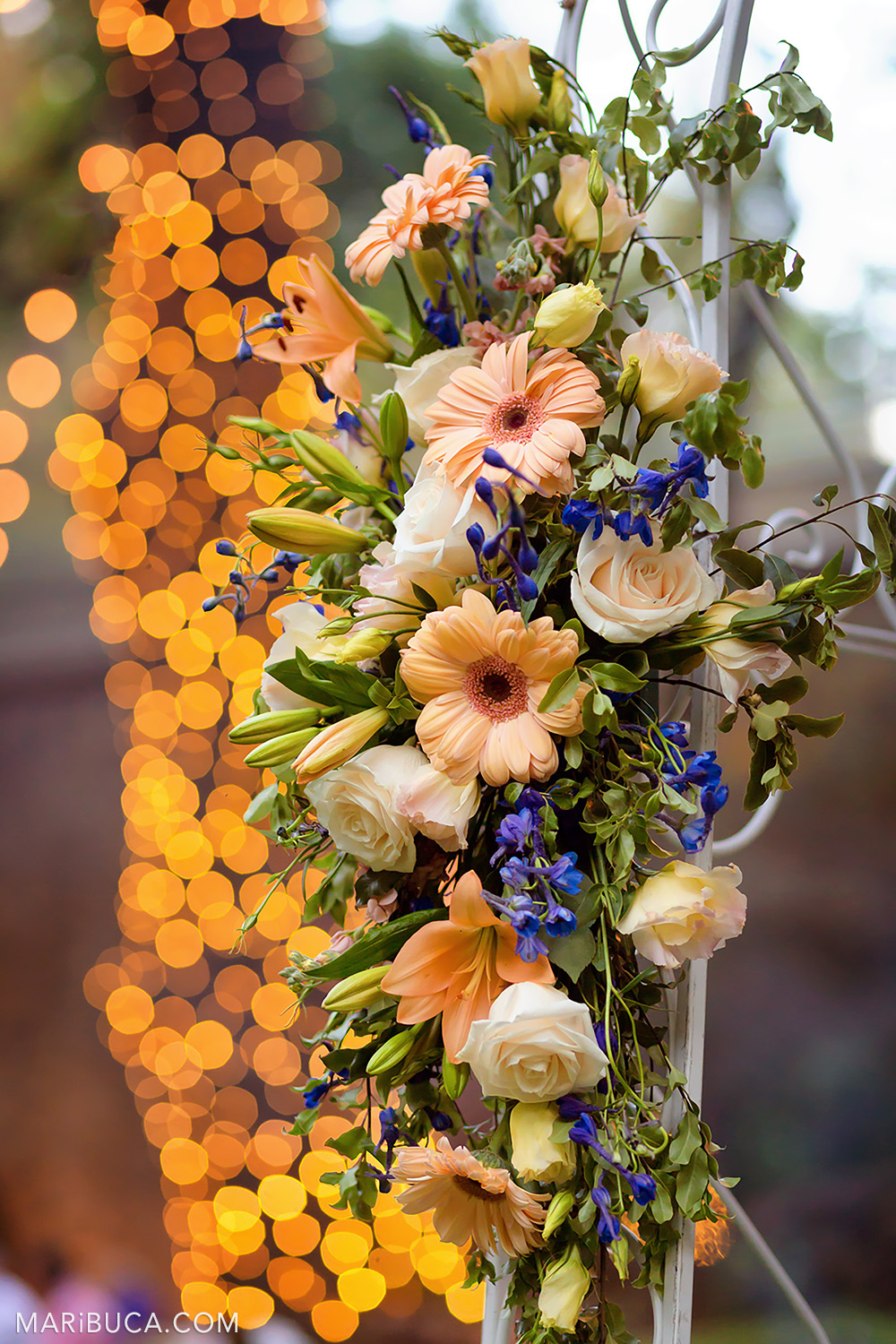 Wedding decoration of the fresh light orange flowers and orange bokeh in the background in the Saratoga Springs Wedding