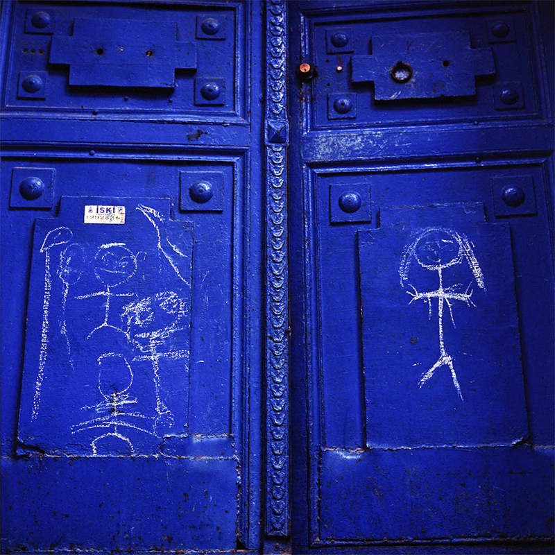 Door with childish drawings.