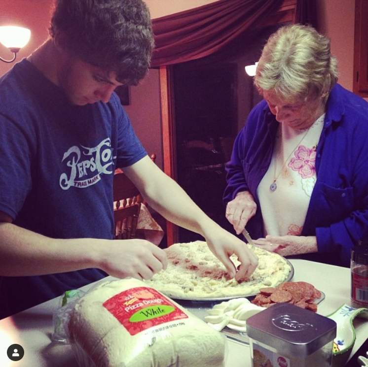 luke and granny makin pizza.PNG