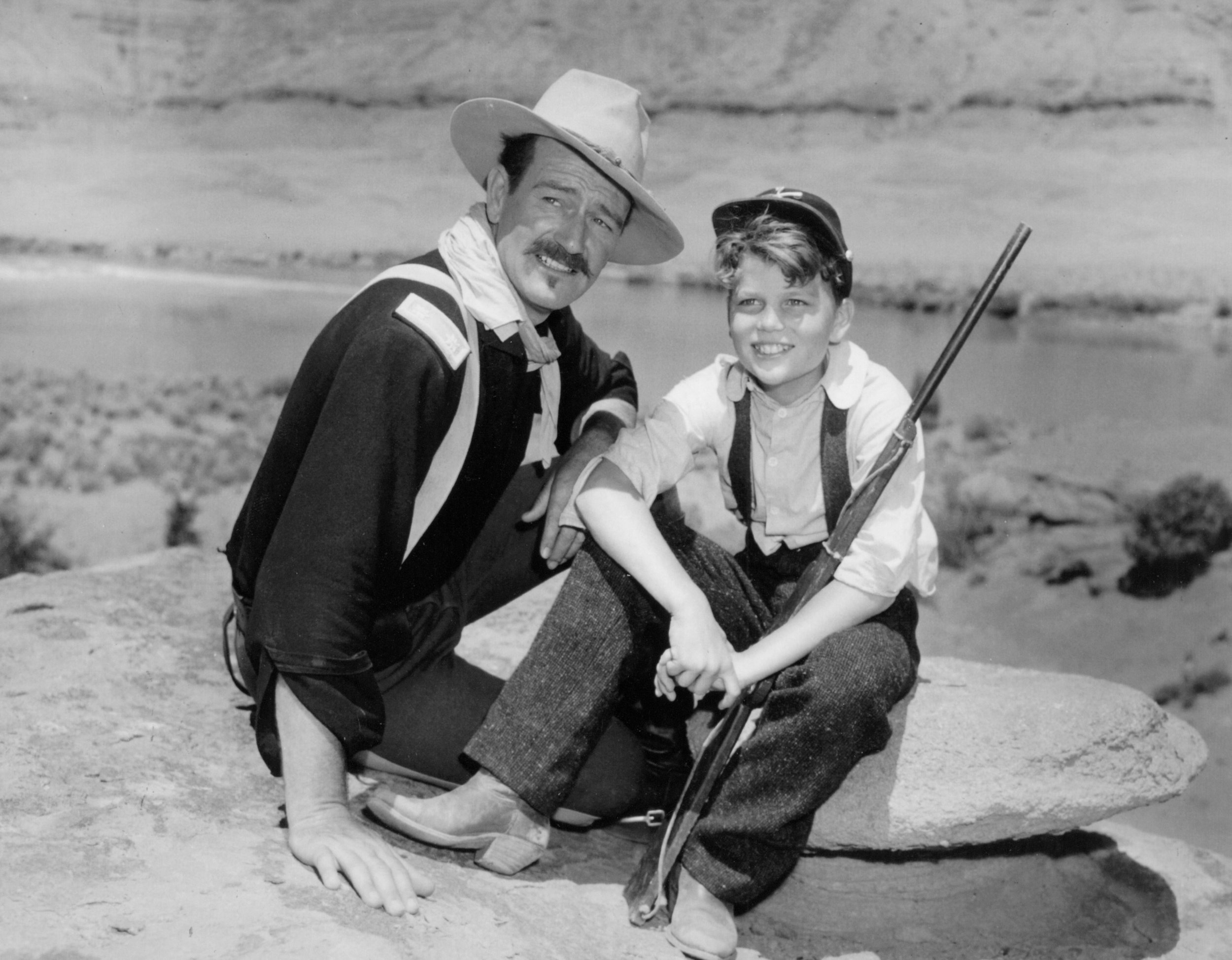 John Wayne (left) and Patrick Wayne (right) on the set of  Rio Grande  in 1950. Photo courtesy of John Wayne Enterprises