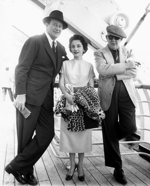John Wayne, Pilar Wayne and John Ford traveling from New York to Southampton aboard the Liberté to see the first James Bond film  Dr. No  in 1963. Photo courtesy of John Wayne Enterprises