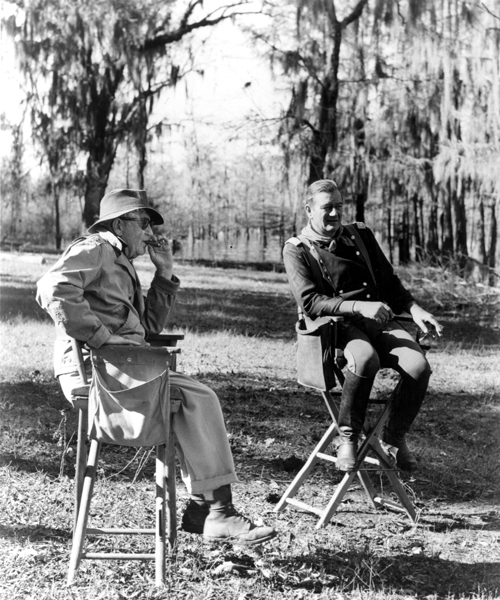 John Ford and John Wayne on the set of  The Horse Soldiers  (1959). Photo courtesy of United Artists