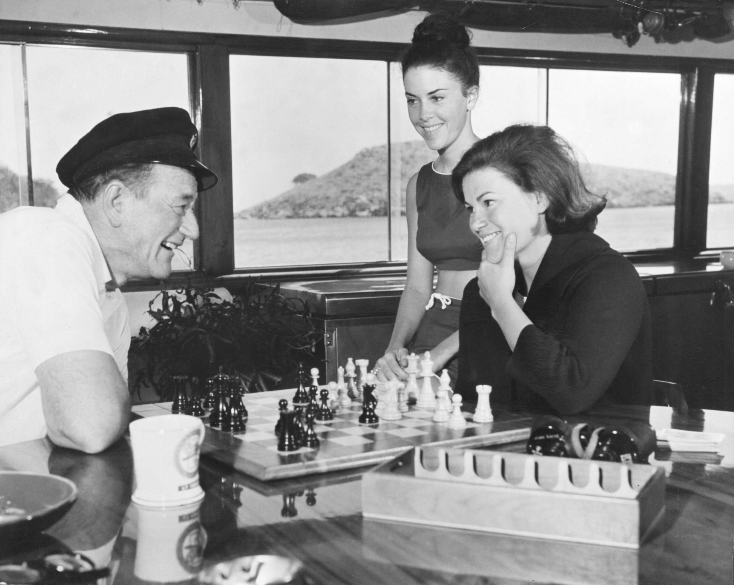 John Wayne, Peggy Wayne, and Melinda Wayne aboard the Wild Goose in 1963. Photo courtesy of John Wayne Enterprises