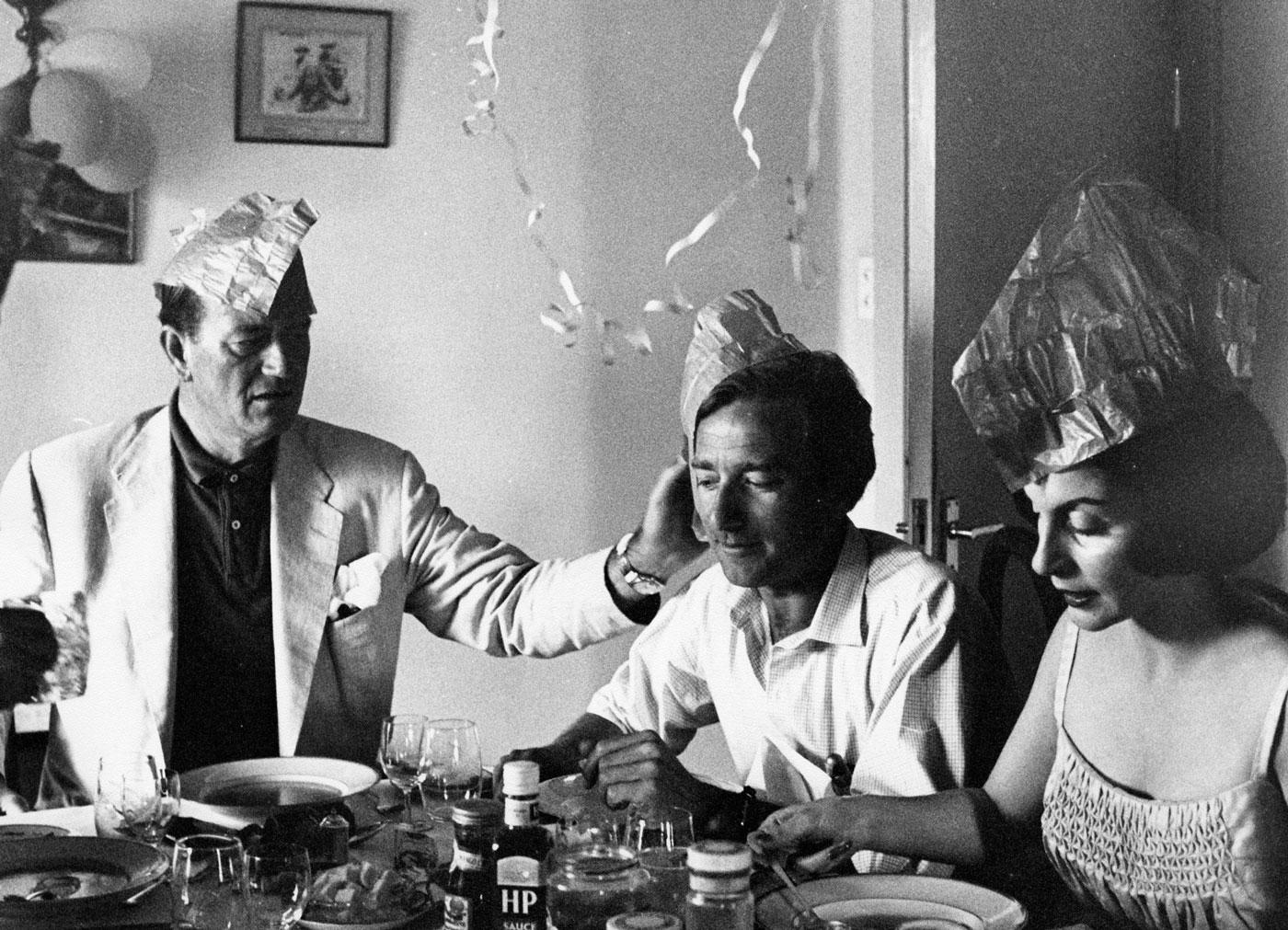 John Wayne and Pilar Wayne enjoying a celebratory dinner with friends in Africa. Photo courtesy of John Wayne Enterprises