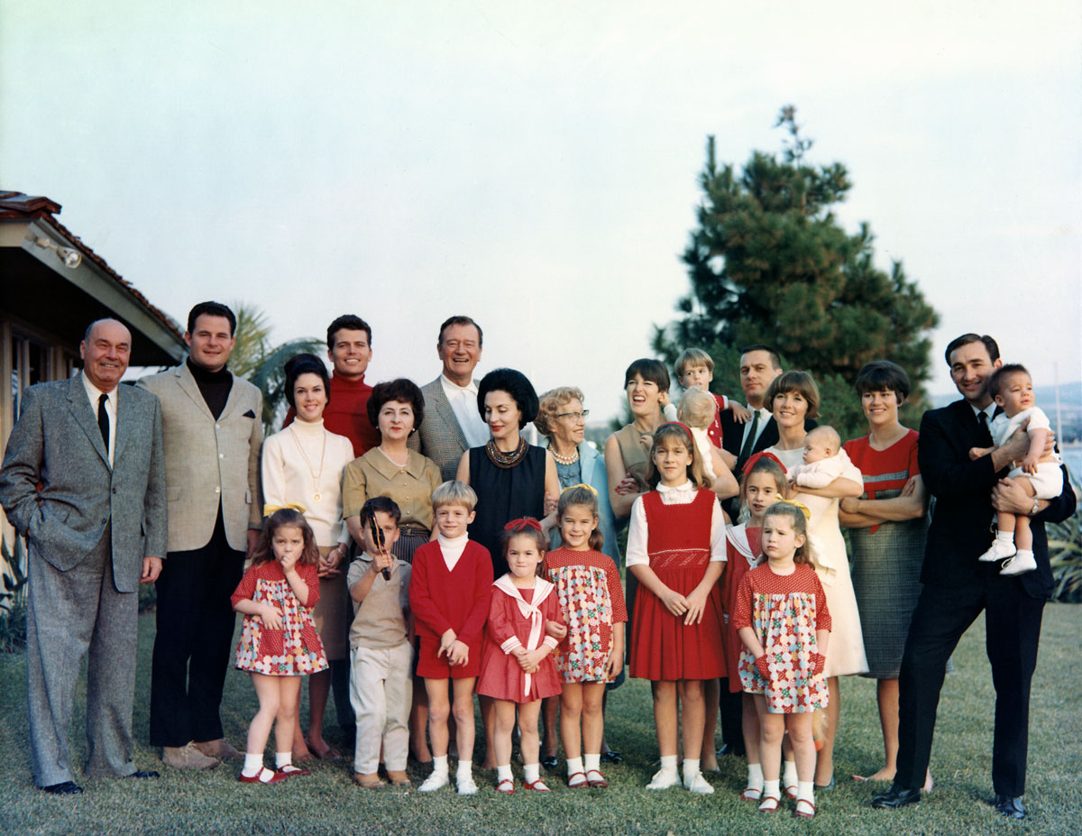 The entire Wayne Family poses for their Christmas card photo at John Wayne's home in Newport Beach, California, circa 1965. Photo courtesy of John Wayne Enterprises