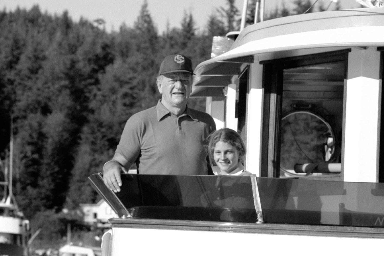 John Wayne and Marisa Wayne aboard Duke's boat the  Wild Goose  in the Pacific Northwest. Photo courtesy of John Wayne Enterprises
