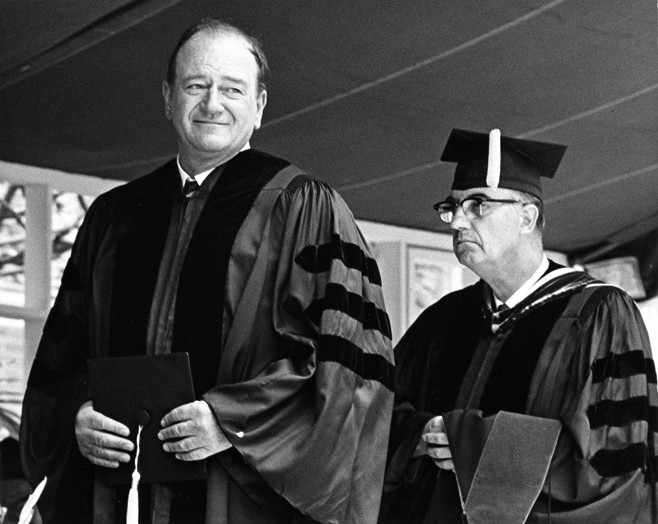 John Wayne (left) receiving his honorary doctorate degree from USC in 1968.