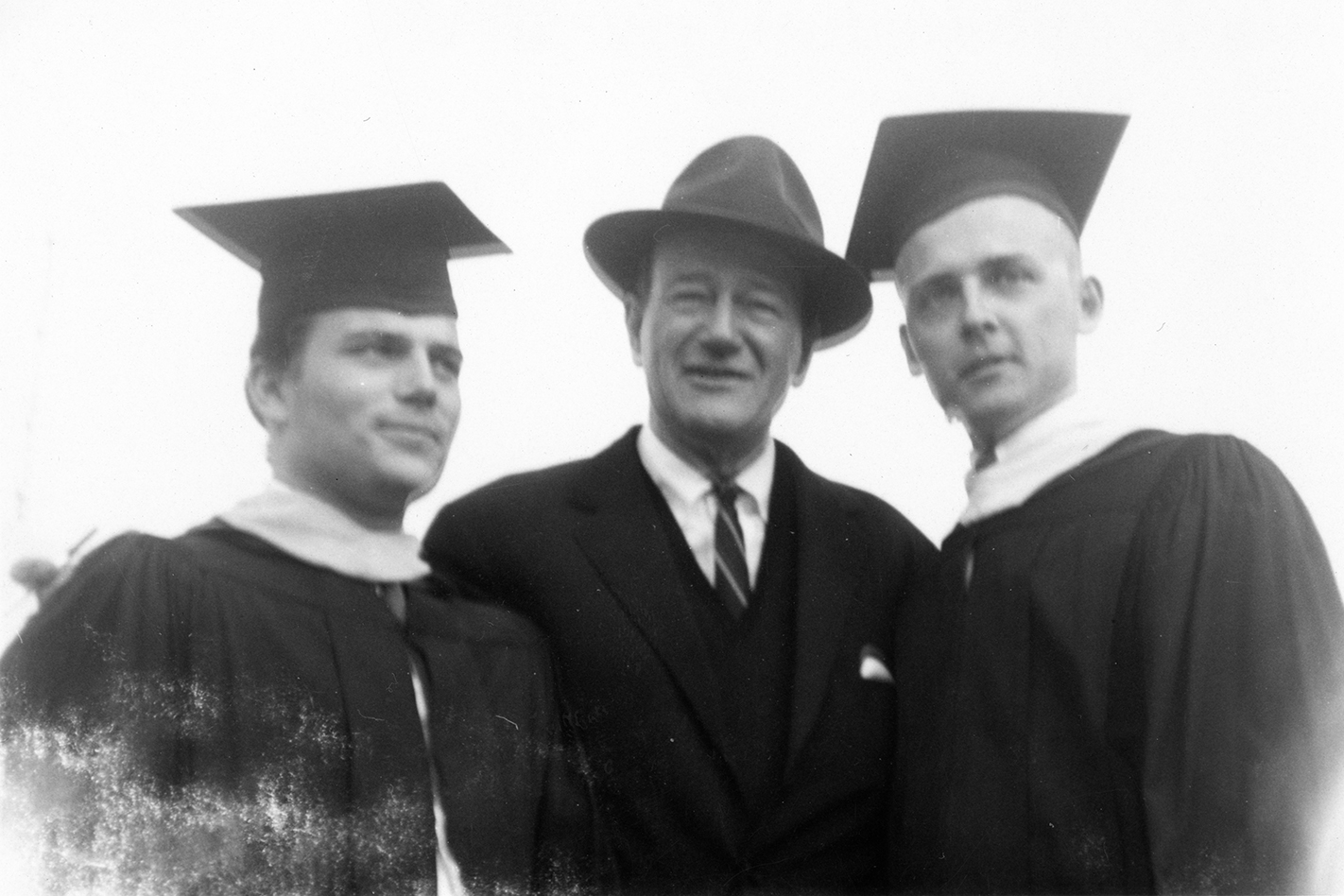 John Wayne (center) with son Patrick (left) at his graduation from LMU in 1961.