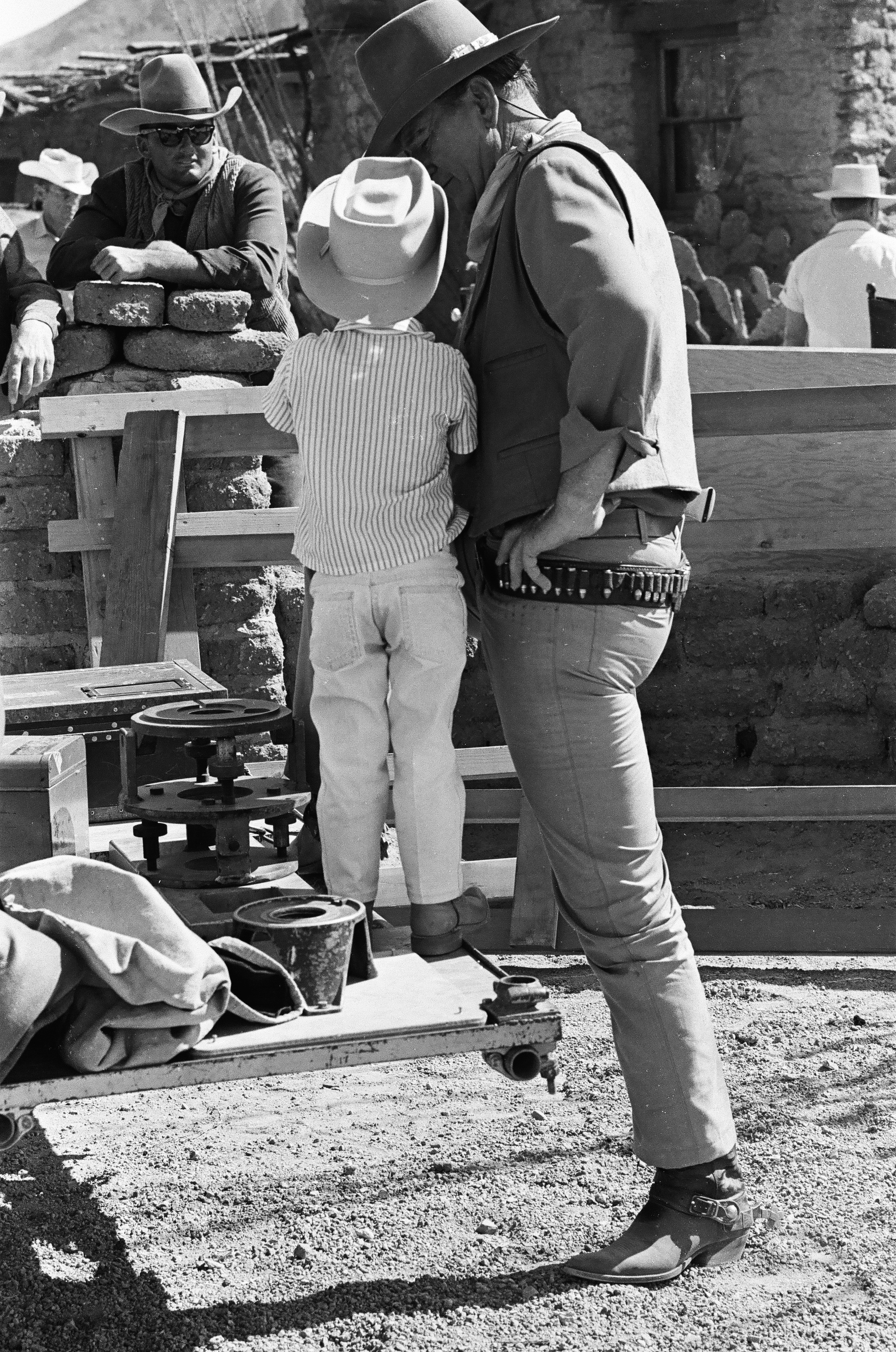 John Wayne with his son Ethan on the set of  El Dorado , c. 1966.