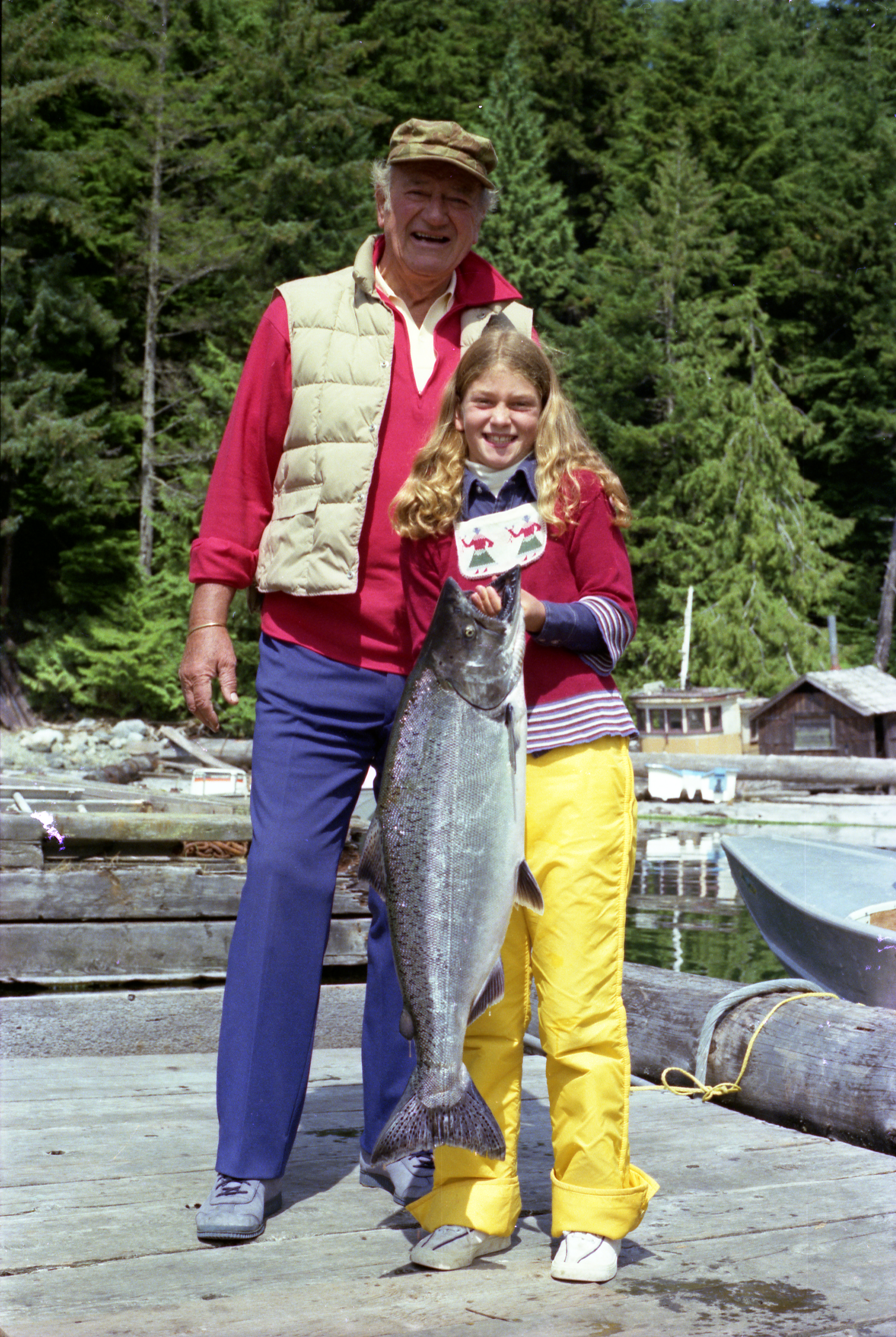 Marisa and her father fishing on the Pacific Northwest during one of their many family trips aboard  Wild Goose .