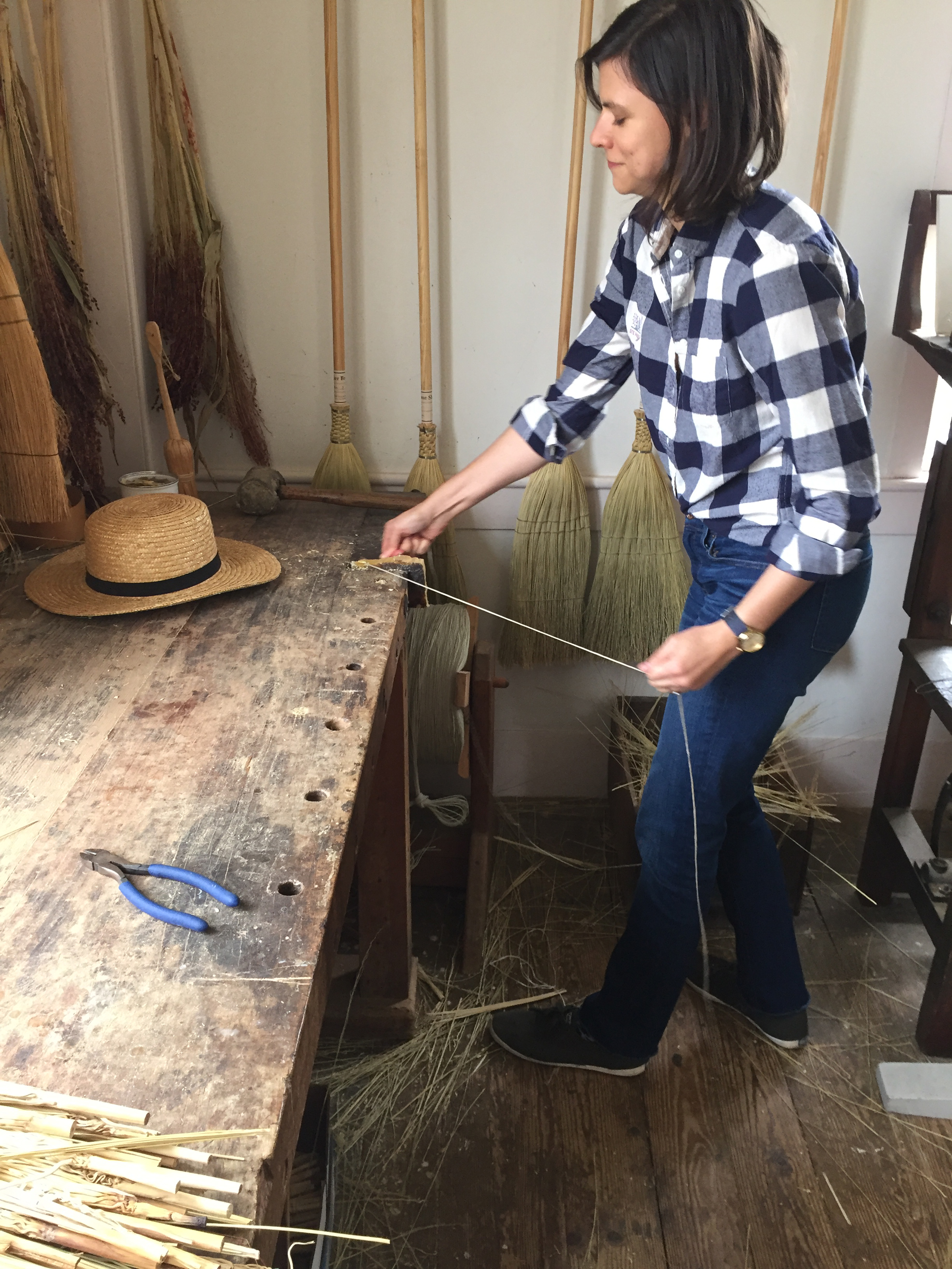 Artisan Erin Rouse handweaves high-quality brooms in her Brooklyn studio.