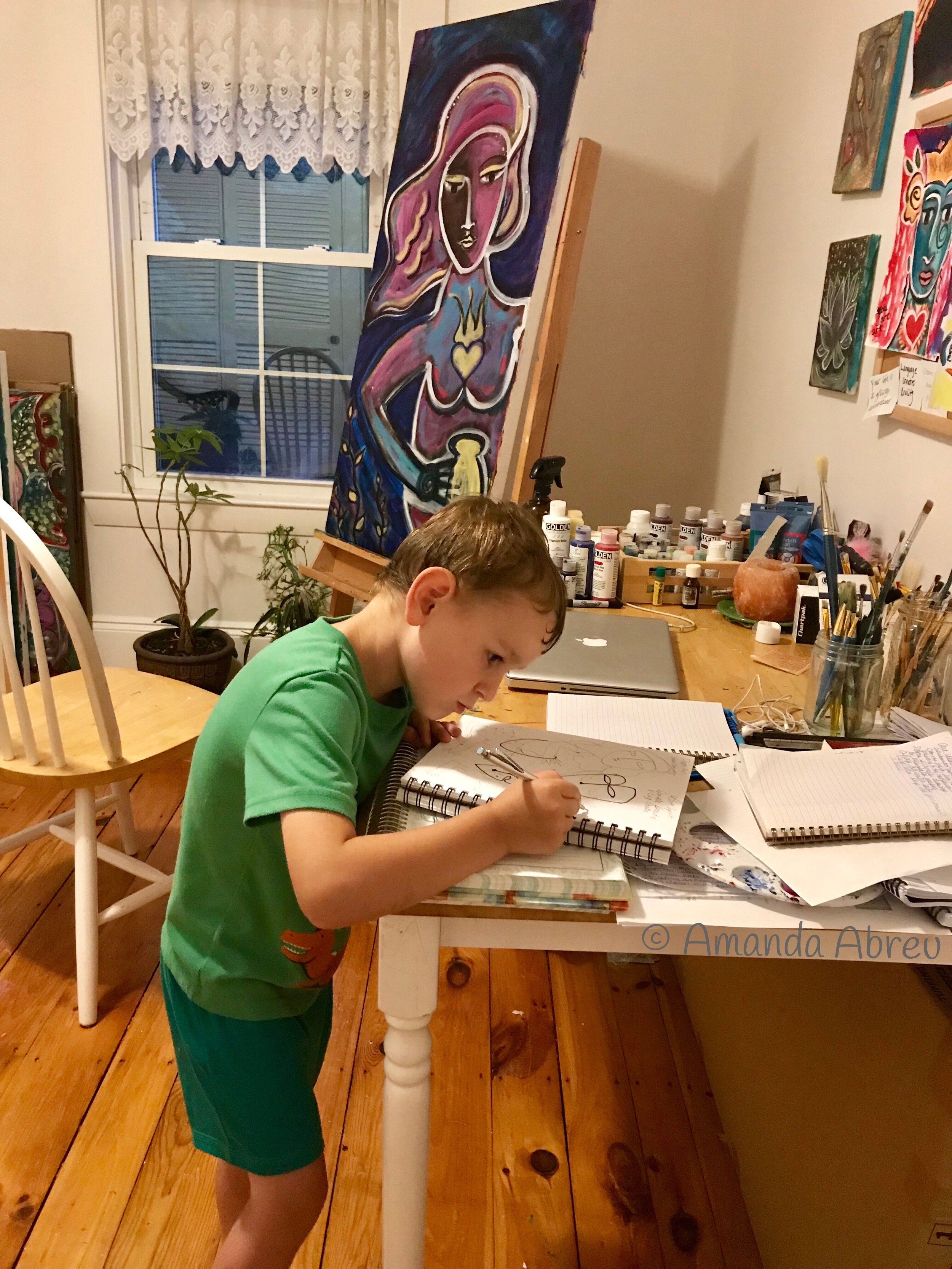 here is my son, naming my paintings.