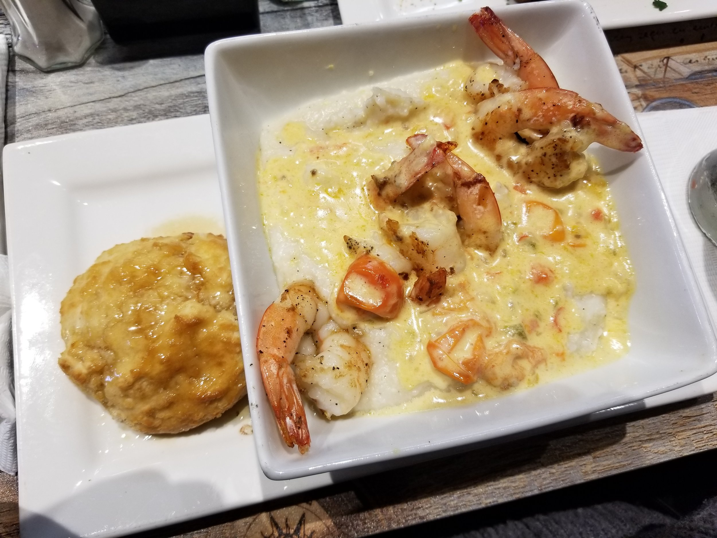Shrimp & Grits- $15.95  Sautéed shrimp in Gocha's tasty garlic herb tomato roux served over creamy grits.