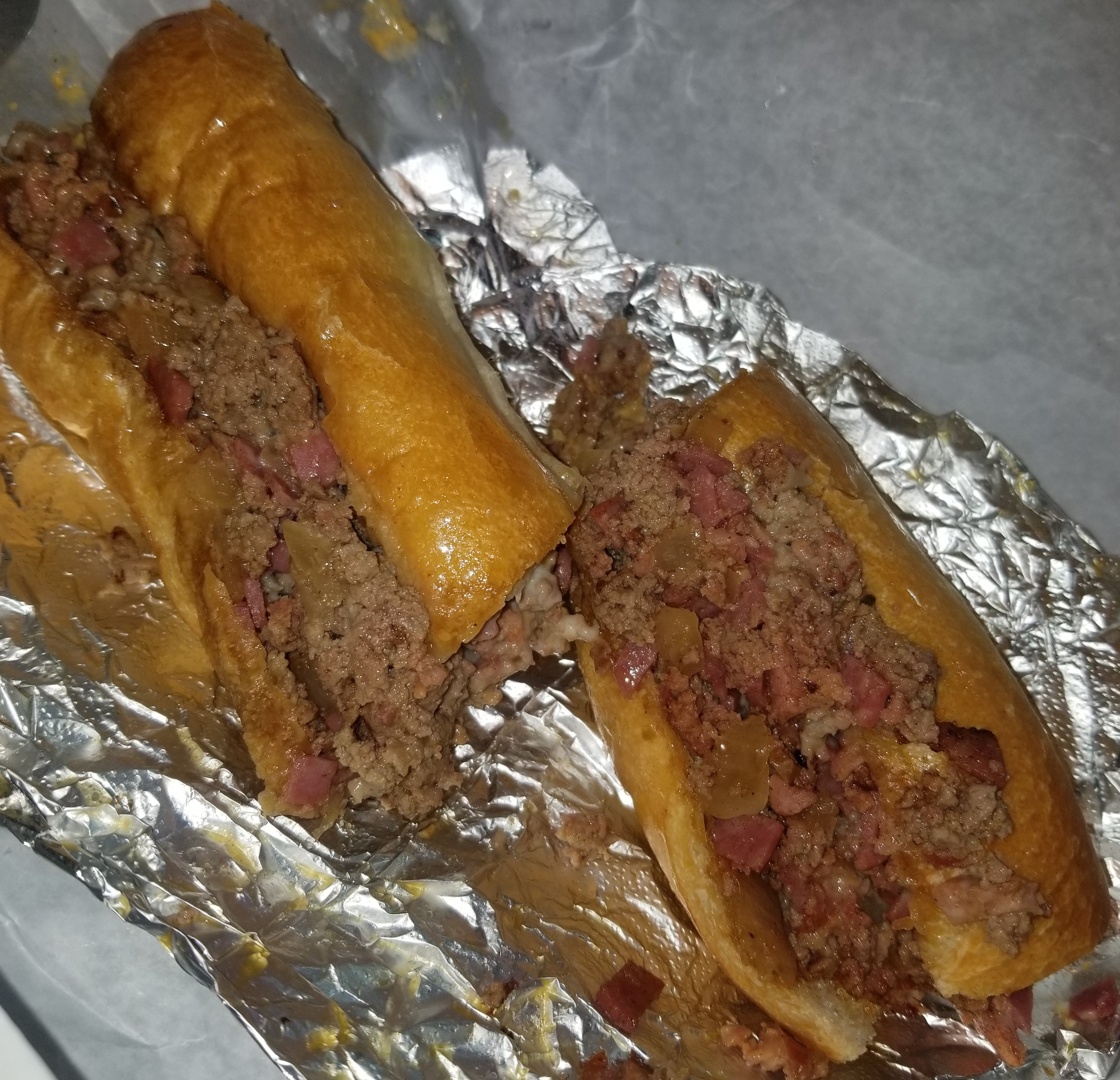 "Also at Beck's I tried the ""Trainwreck"" which has steak, salami, andouille sausage, cheese and onions; Only $10.95.  Not pictured is the classic banana pudding from Sweet Nina's the banana pudding was sooo good, I didn't even have time to take a picture."