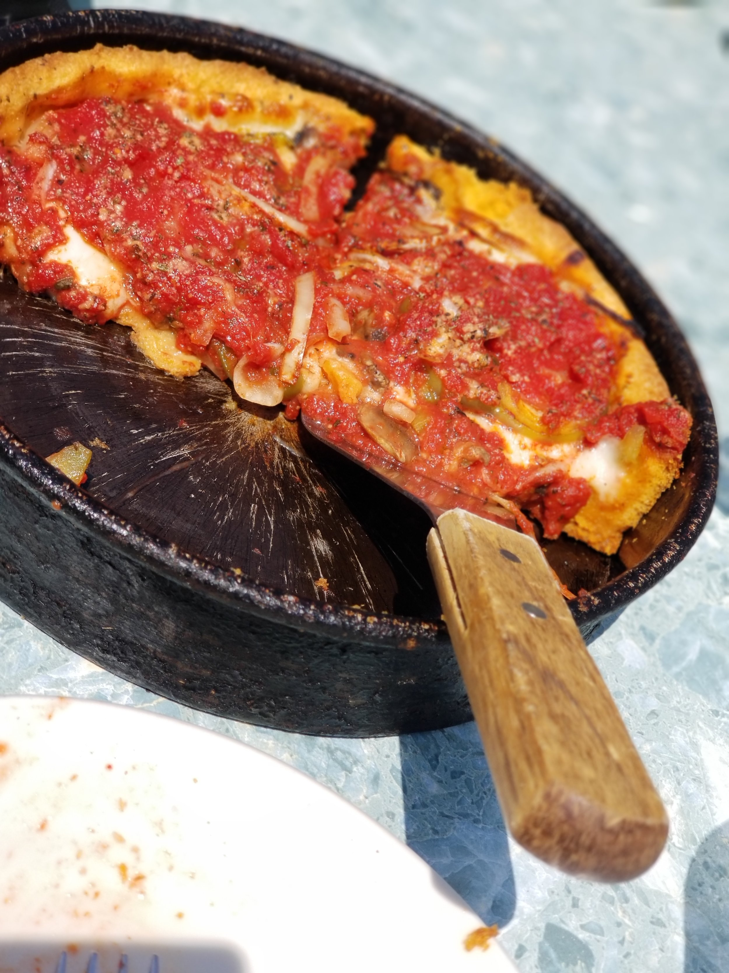 I was told you couldn't go to Chicago and not try the deep dish casserole ( I mean pizza) I was highly disappointed when we went to Gino's East.  The pizza is cooked in a wood  fired oven which takes about 45 minutes to be done.  The tomato sauce was very watery and lacked flavor.  For the pizza to take 45 minutes to cook, it came out cold..  Gino's was definitely my least favorite restaurant the entire trip