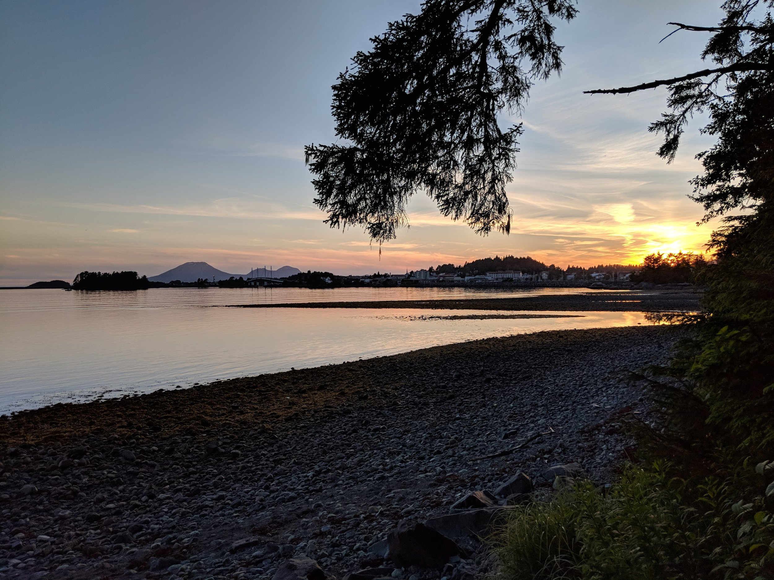 Sitka, Alaska. Taken around 11pm in the summer from Totem Park with Mt. Edgecomb in the background.  @roger.cummings