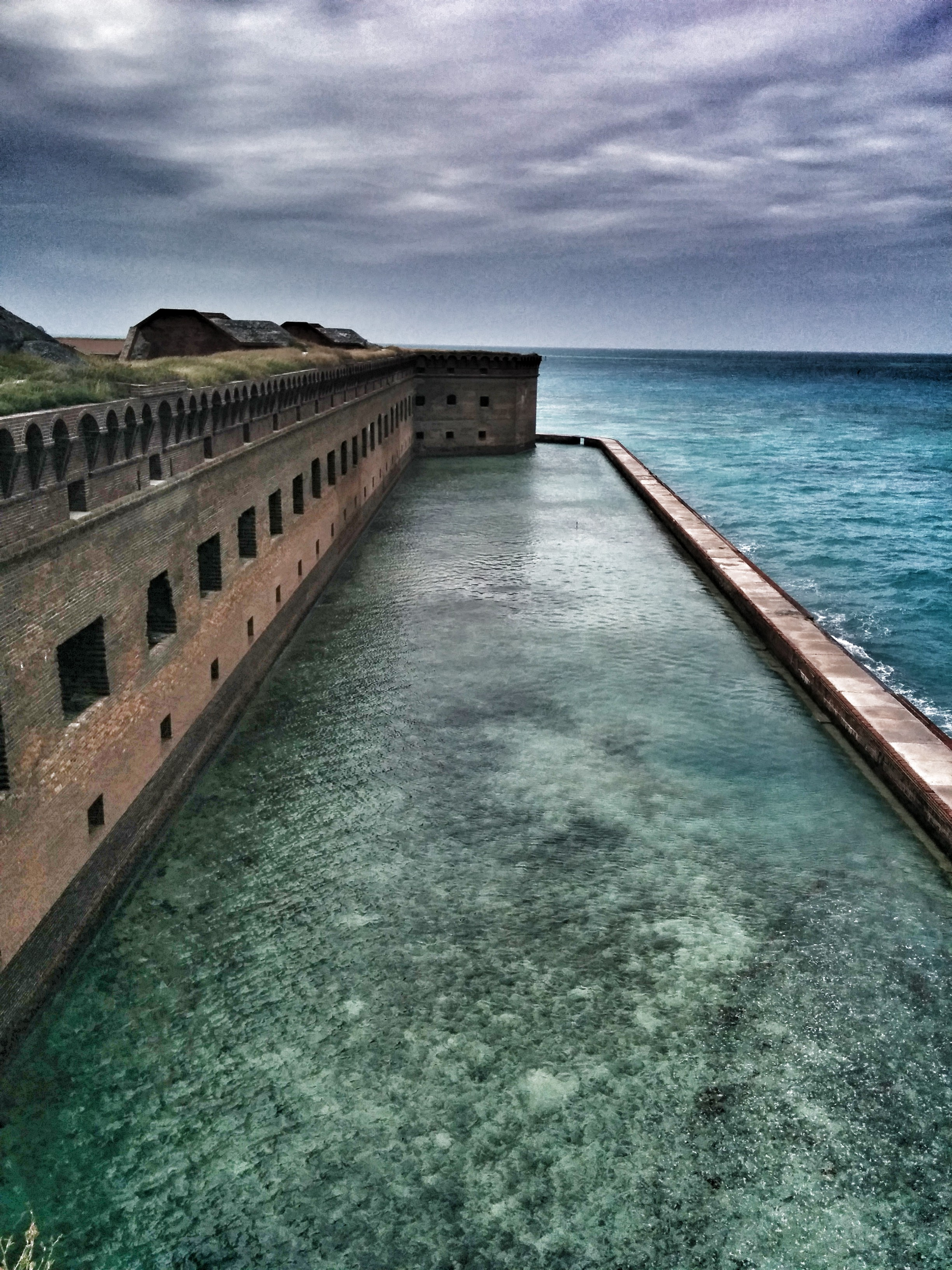 Part of the moat @ Fort Jefferson,  Dry Tortugas National Park . We took a float-plane (bucket list!) to this site on our honeymoon. Built (though never finished) as a fortress and then used as a prison for criminals and deserters of the Civil War, it remains surrounded by shipwreck sites and coral reefs.  @roger.cummings