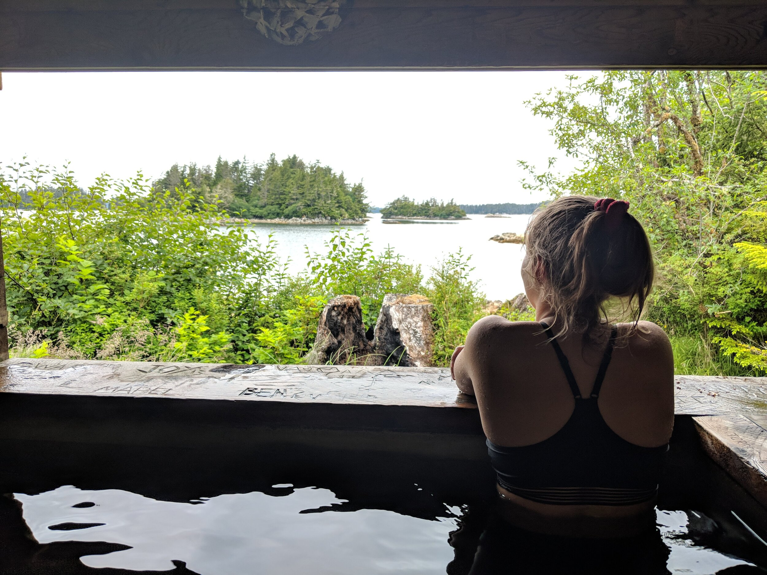 Roger's youngest daughter, Mykayla, enjoying the view from  Goddard Hot Springs , a remote location in Southeast Alaska.
