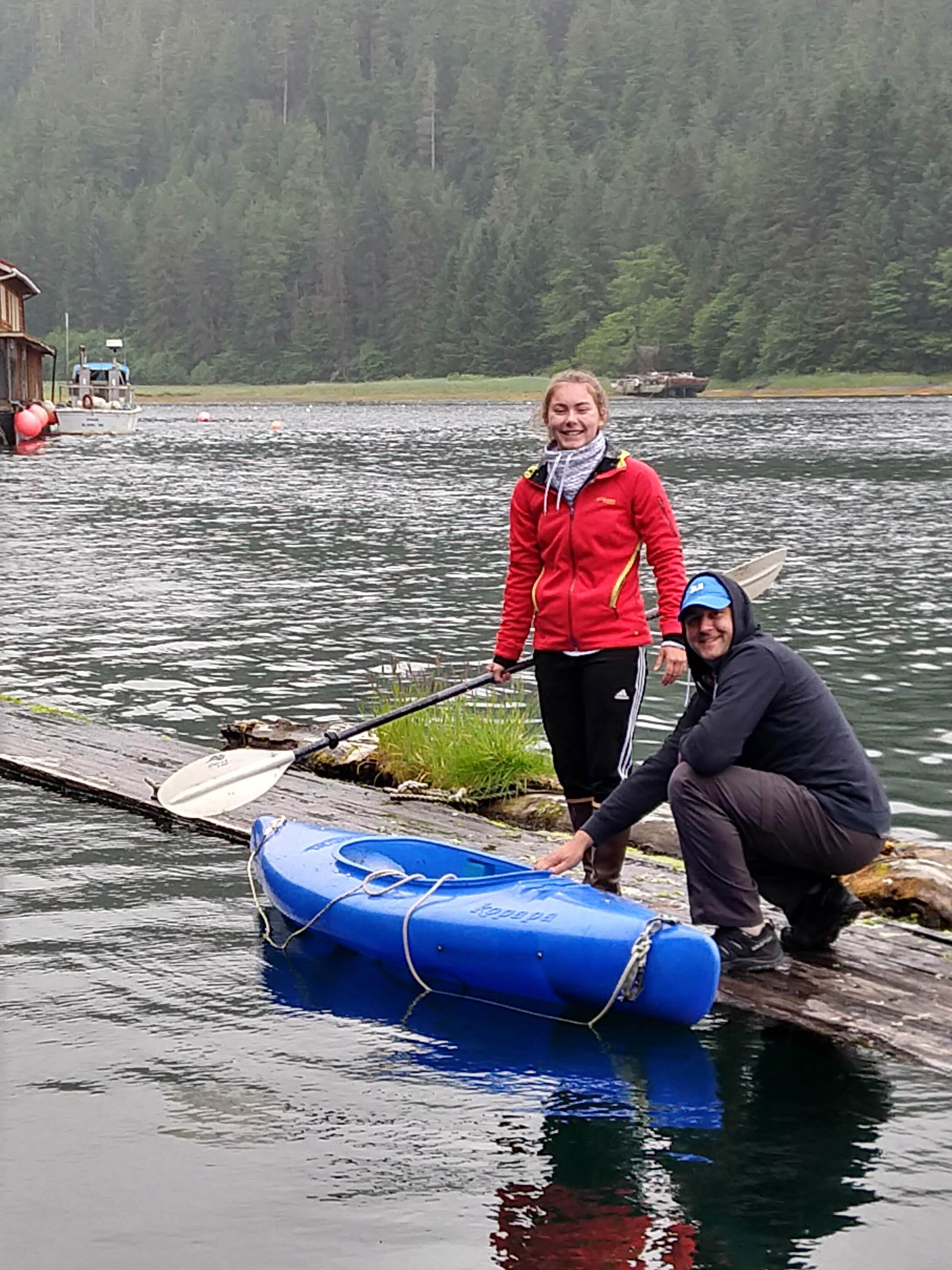 I came of age in this wild place, but this was the first time we brought Roger's youngest daughter to Alaska. They are trying to navigate how to get into a kayak from a floating log. Taken @  Camp Coogin Bay  at my parents' floathouse in Southeast Alaska.