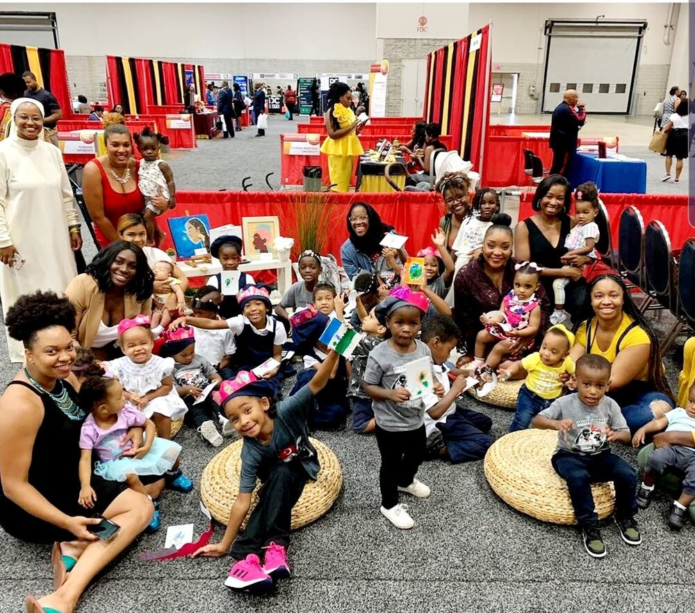 "The Mom's of District Motherhued enjoying ""Read and Play"" featuring a curated reading experience by Busboys and Poets, at the Walter E. Washington Convention Center. Photo Cred: District Motherhued"