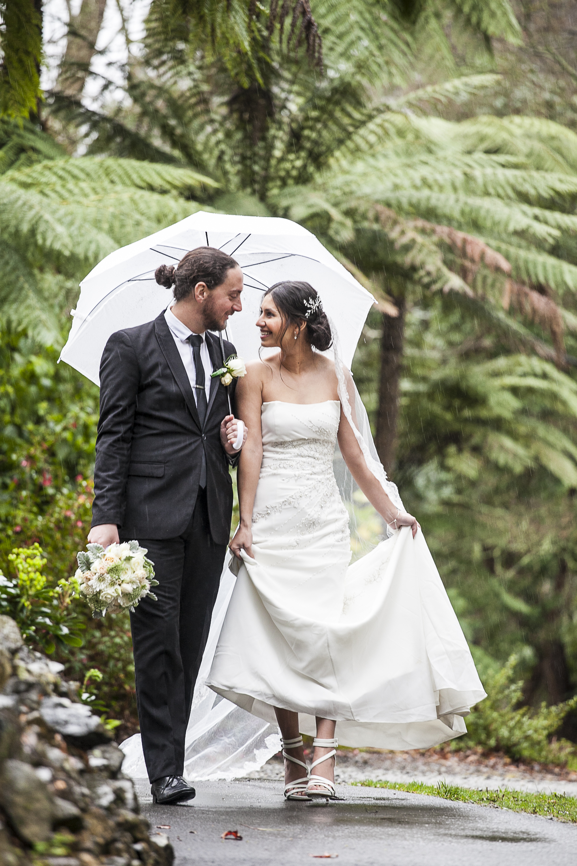 """Tip 1: Rain - One of the top questions I get asked is """"what do you do for our photos if it rains on the wedding day"""". Number one rule is to not think about it to much and especially don't let it stress you out. Unfortunately you cant change the weather so the best thing to do is to embrace it and enjoy the journey.Remember you have booked your dream venue and the best suppliers who have experienced these conditions many times before and are the best people to guide you through it. Be prepared with umbrellas, and why not make them cute lace ones which will look amazing in your photos!Did you know it is actually good luck to get married on a rainy day? No, someone didn't just make that up because it was raining and they were trying to cheer everyone up. You probably didn't know it is actually because you can't untie a wet knot <3Another tip for the day is to have a pair of back up shoes just for the photoshoot which are flats or even wedges to avoid sinking and walking in puddles with your beautiful bridal shoes. You could even have some fun and put on a pair of gum boots and really embrace the day!Lastly, a great photographer will always find beautiful places inside to take photos between the rain showers. It might be the piano in the corner of the dining area that you didn't see as more than a musical instrument. Or in the back up chapel which has stained glass windows that create amazing light effects. You may not see all of these things when you visited the venue because you were captivated by the stunning gardens for your photos, but remember you have paid good money for your photographer and these are the times they are most creative."""