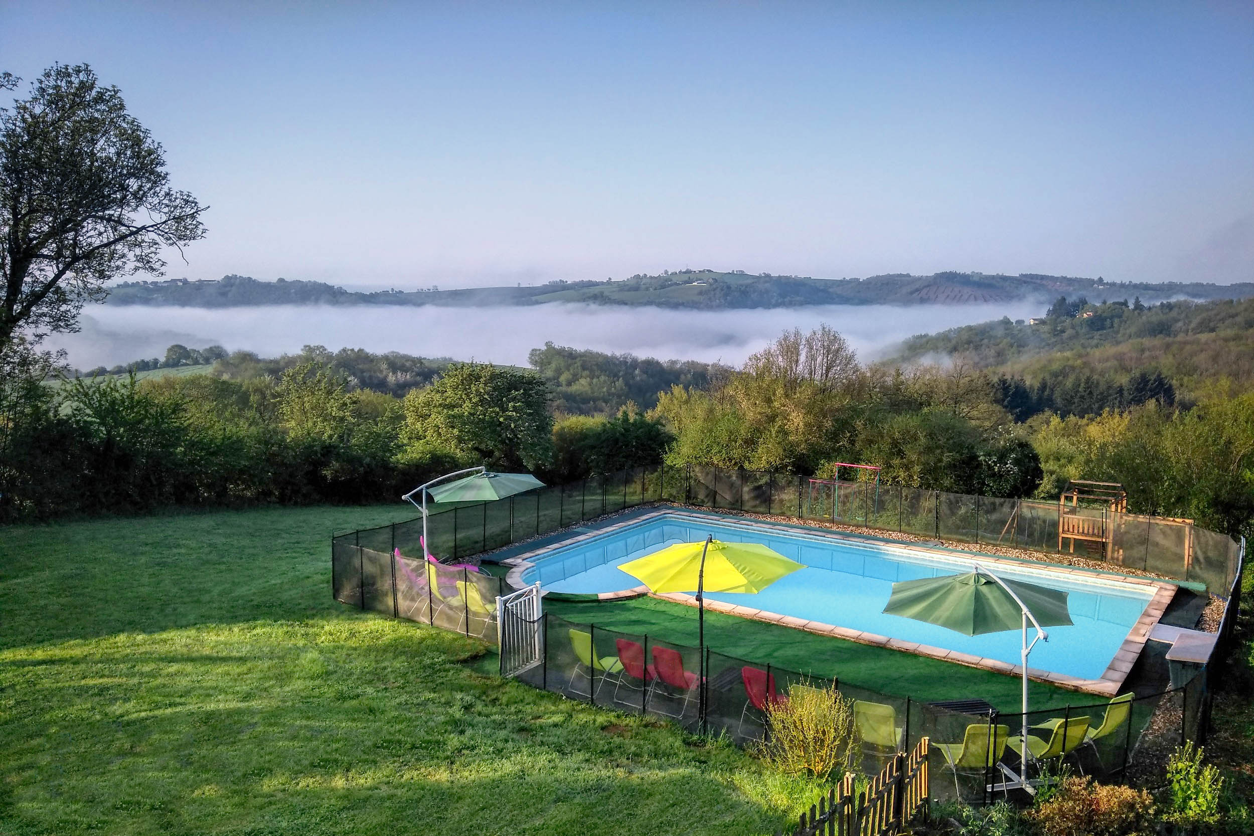 Large swimming pool with views over the stunning Viaur valley