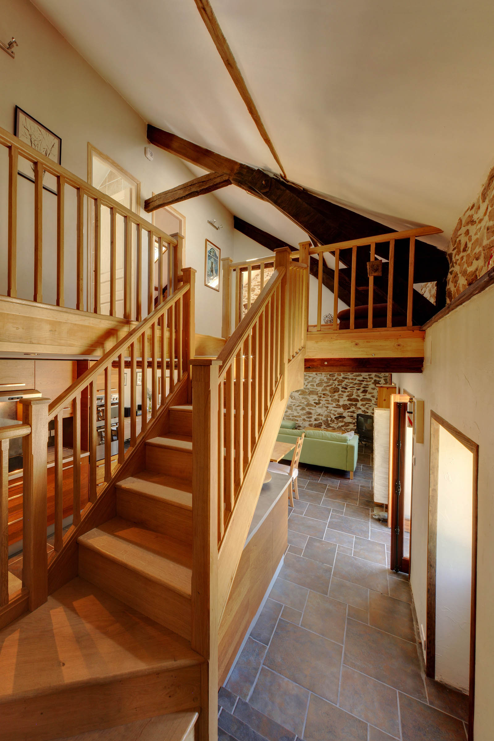 The bespoke oak staircase at the heart of this property