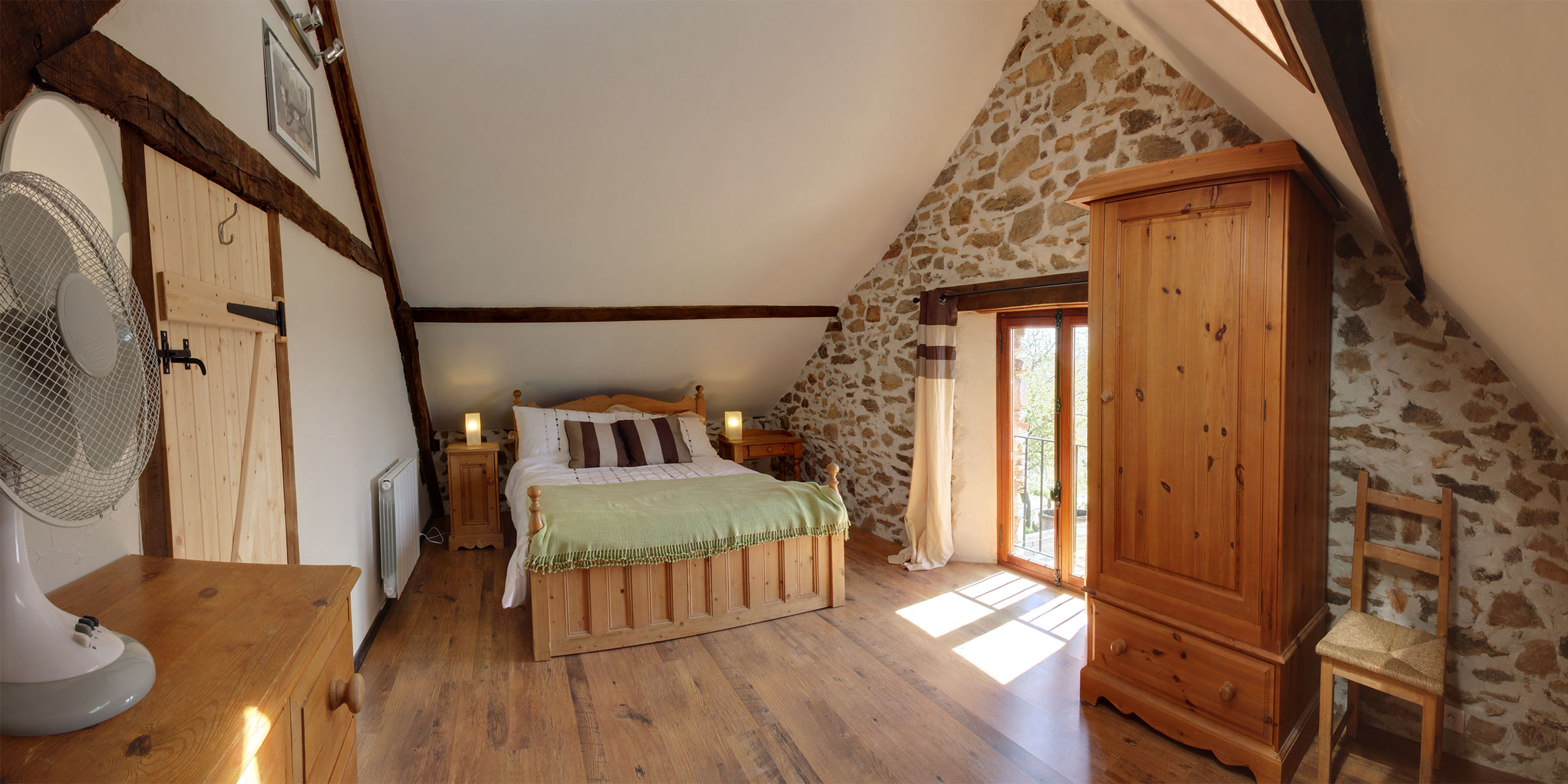 A double room with a view over the pool and Viaur valley beyond
