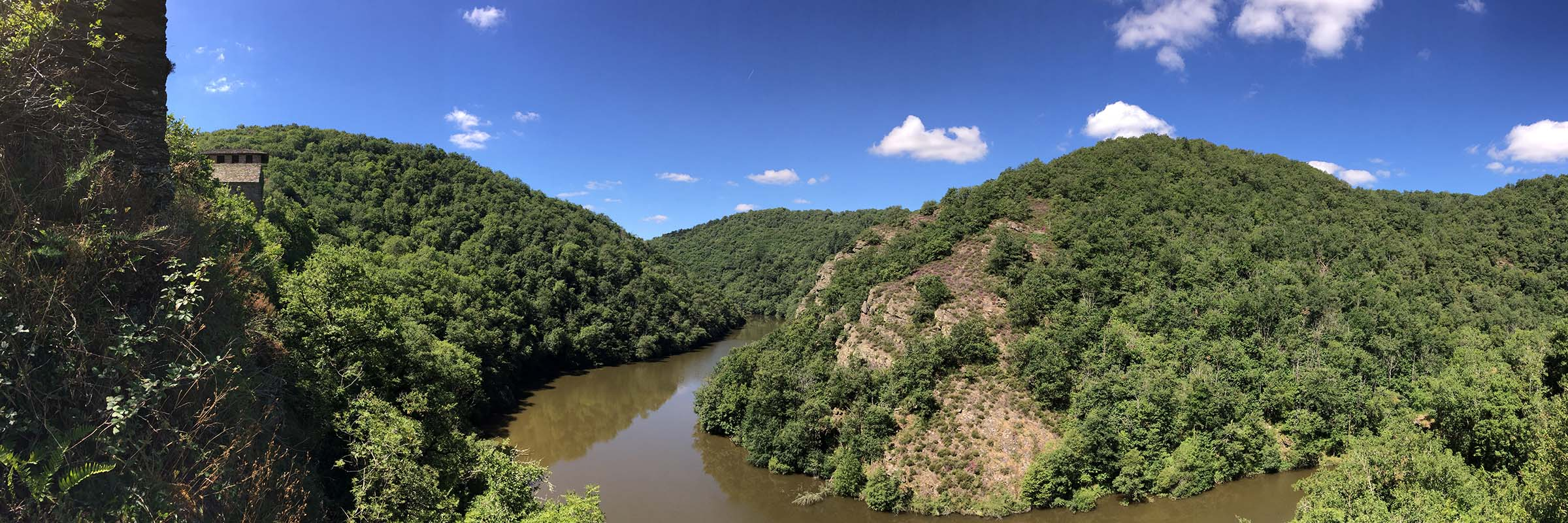 Panoramic view of the Viaur river with Las Plaques overlooking high on the left