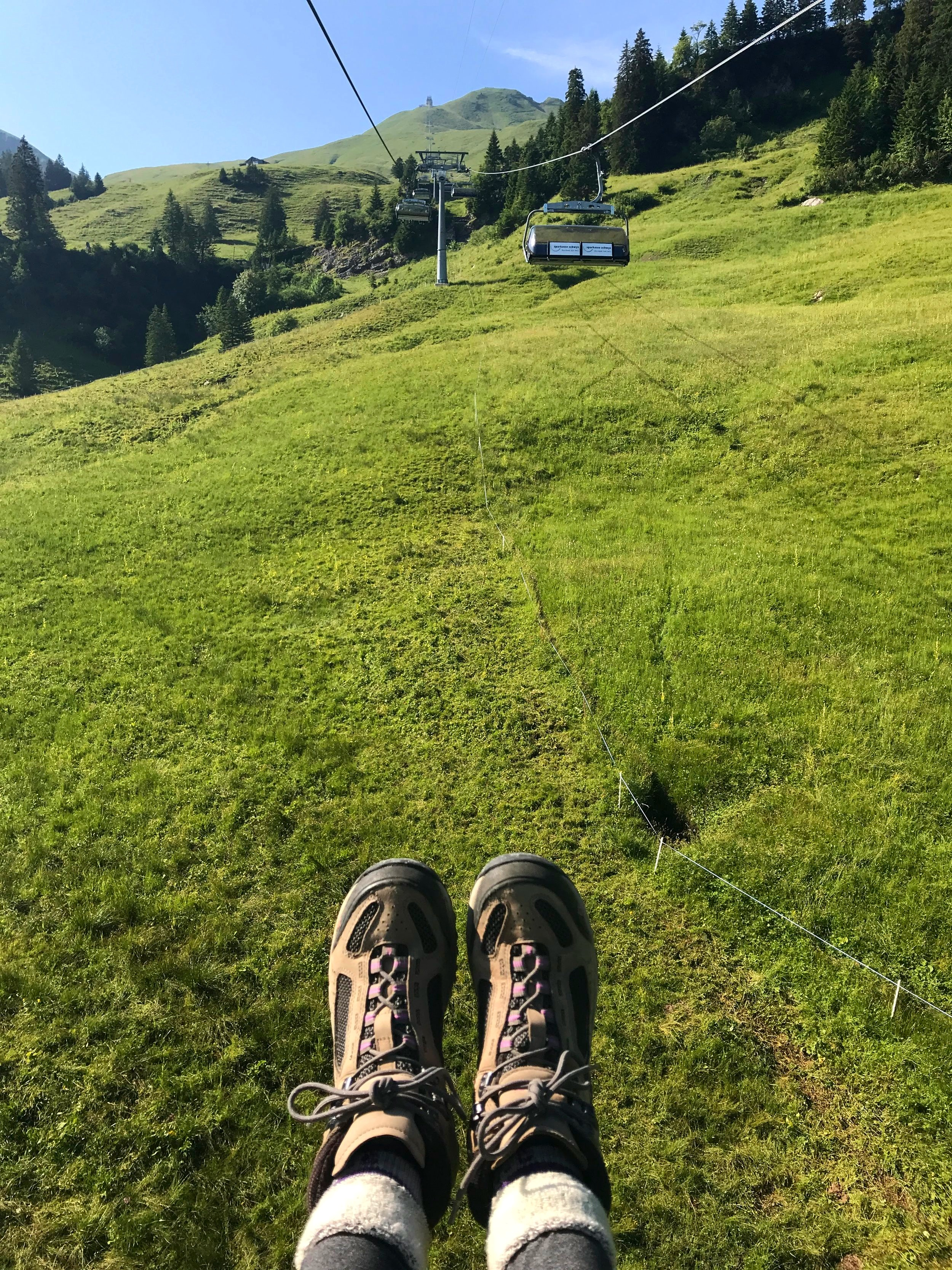 Riding a cable car to the start of the Pizol Five Lakes Hike
