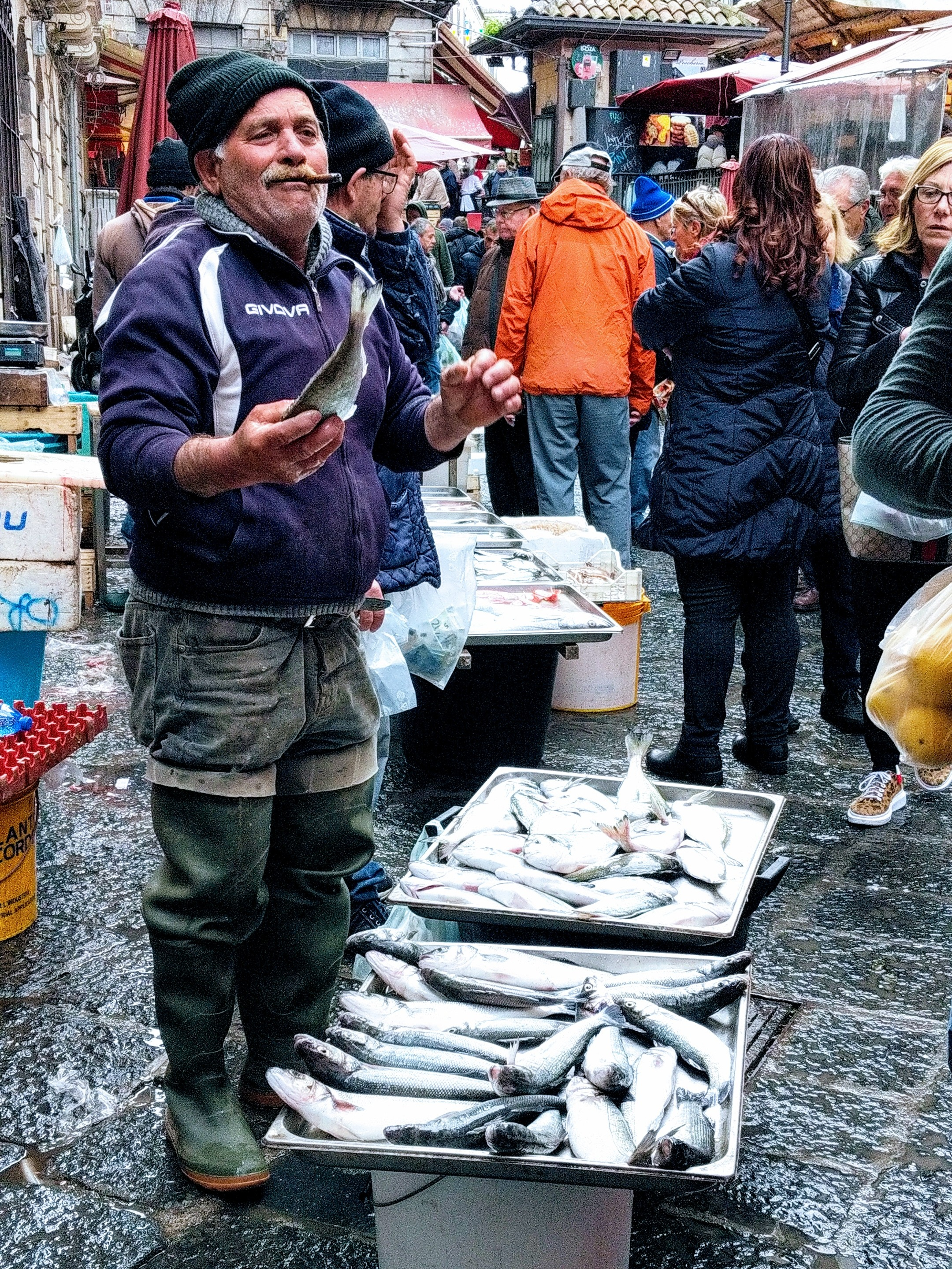 Fishmonger at the fish market in Catania, Sicily