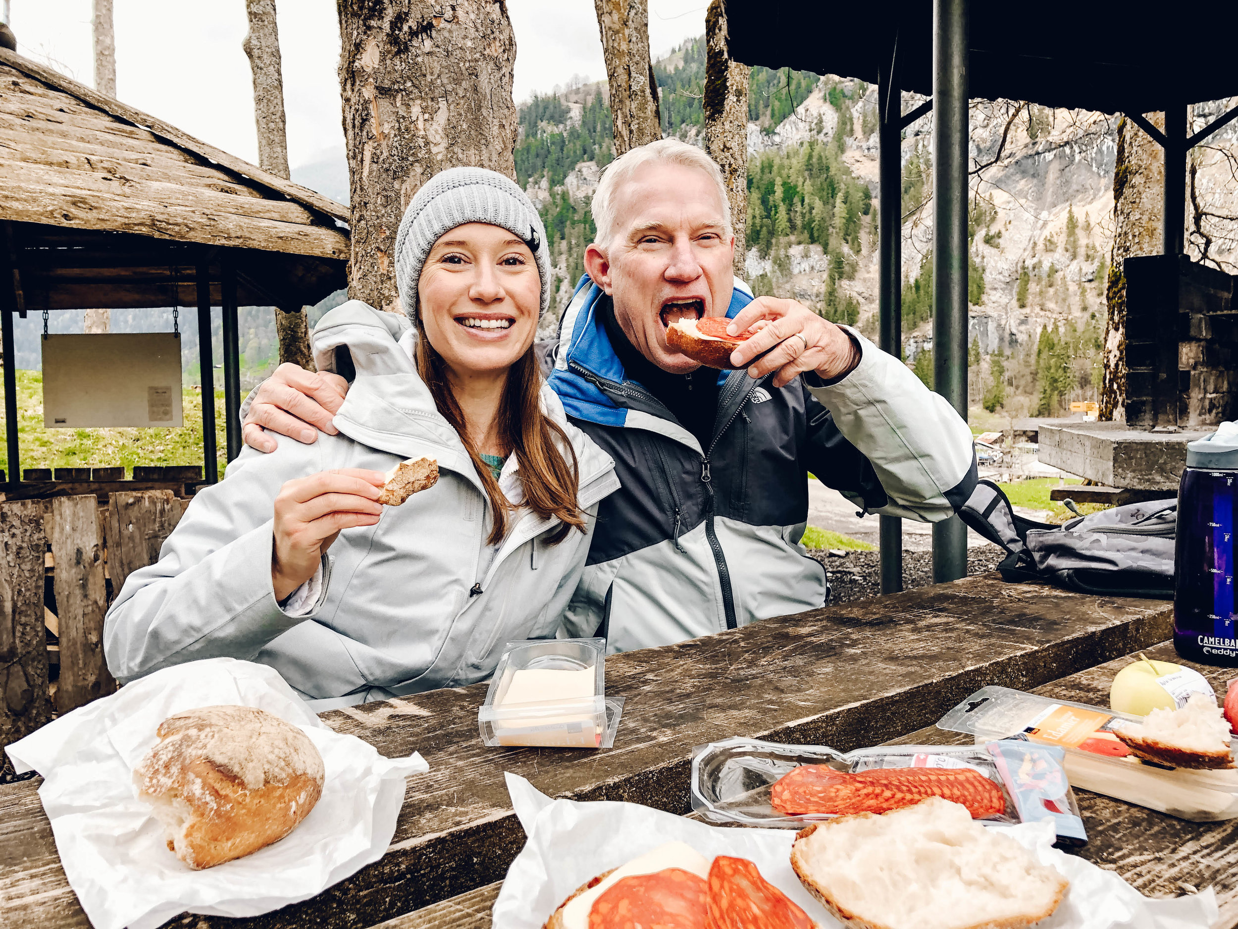 Eating lunch with Dad while on hike in Lauterbrunnen Switzerland