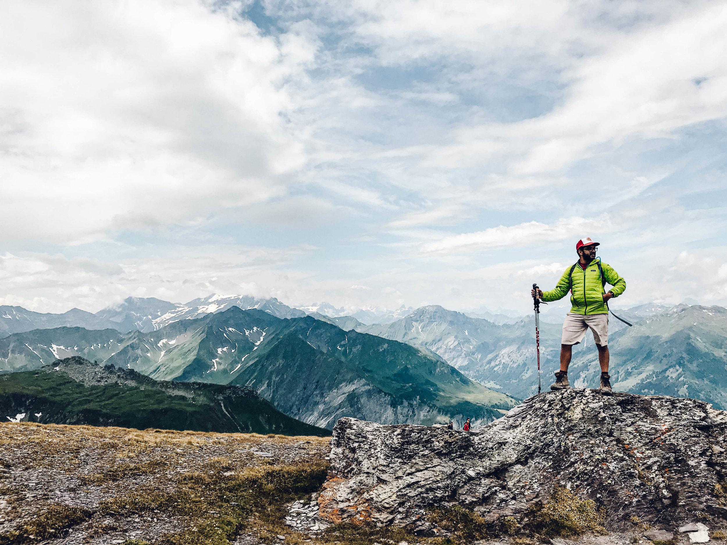 Raunaq with hiking poles on Pizol 5 Lakes Trail.jpg